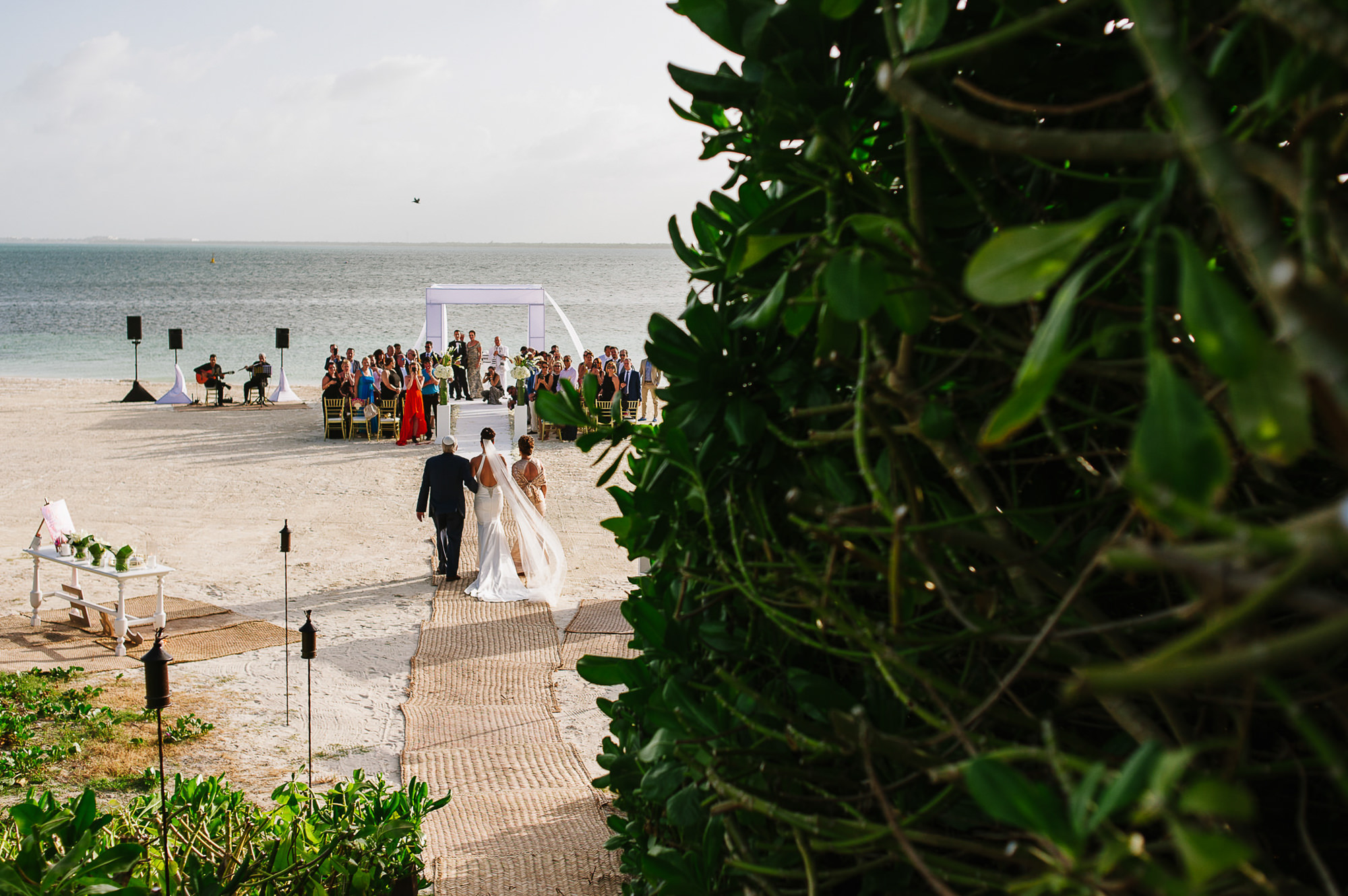 bride-walked-by-clients-to-ceremony-on-the-beach-worlds-best-wedding-photos-citlalli-rico-mexico-wedding-photographers