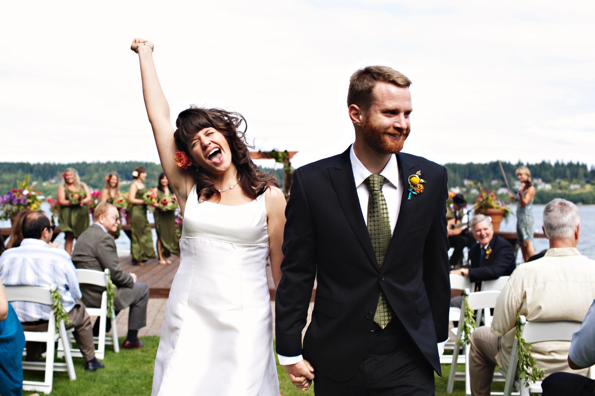 Estatic bride and groom celebrate being married - photo by Jenny Jimenez