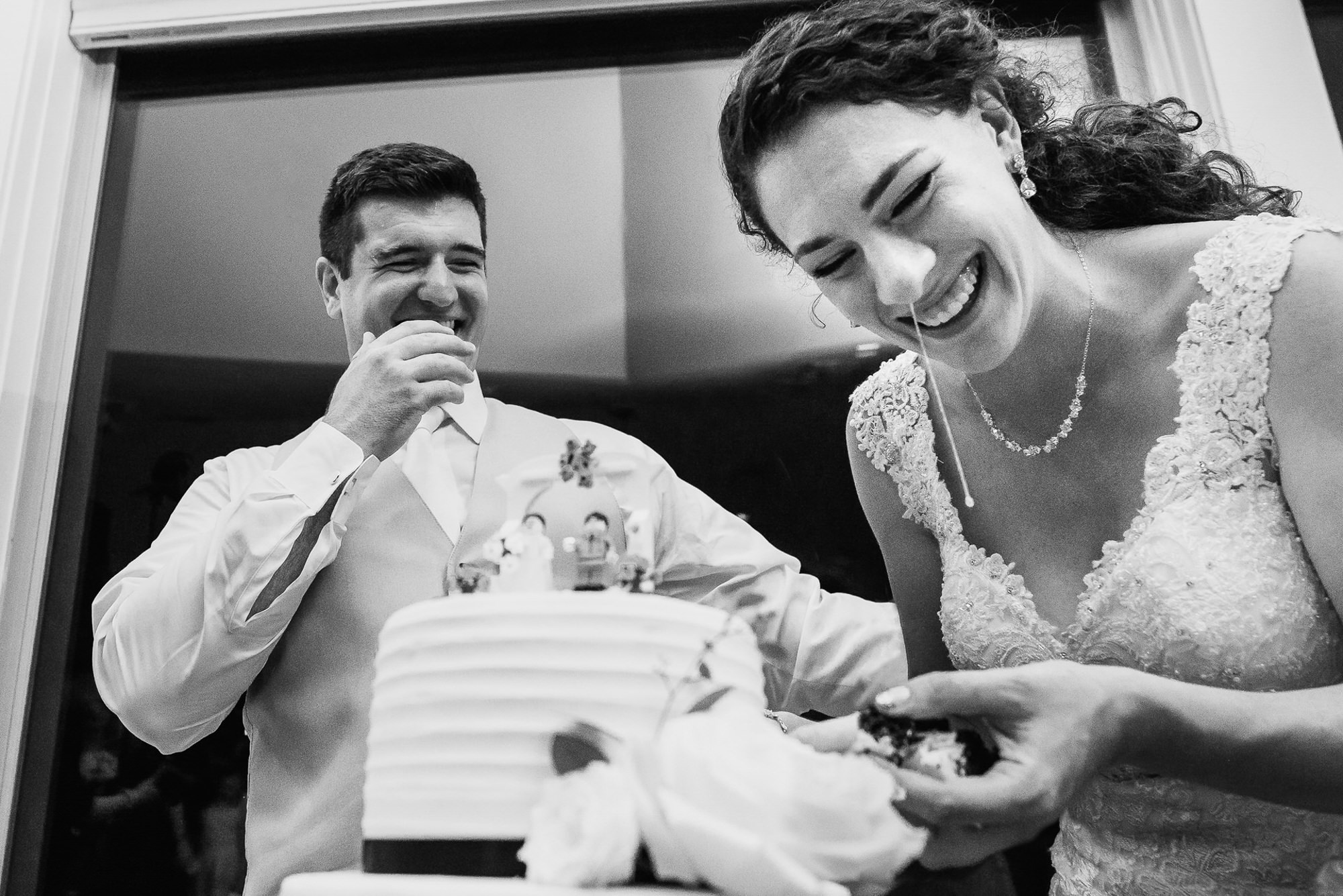 Bride cuts the cake with her nose running - photo by Ken Pak - Washington D.C