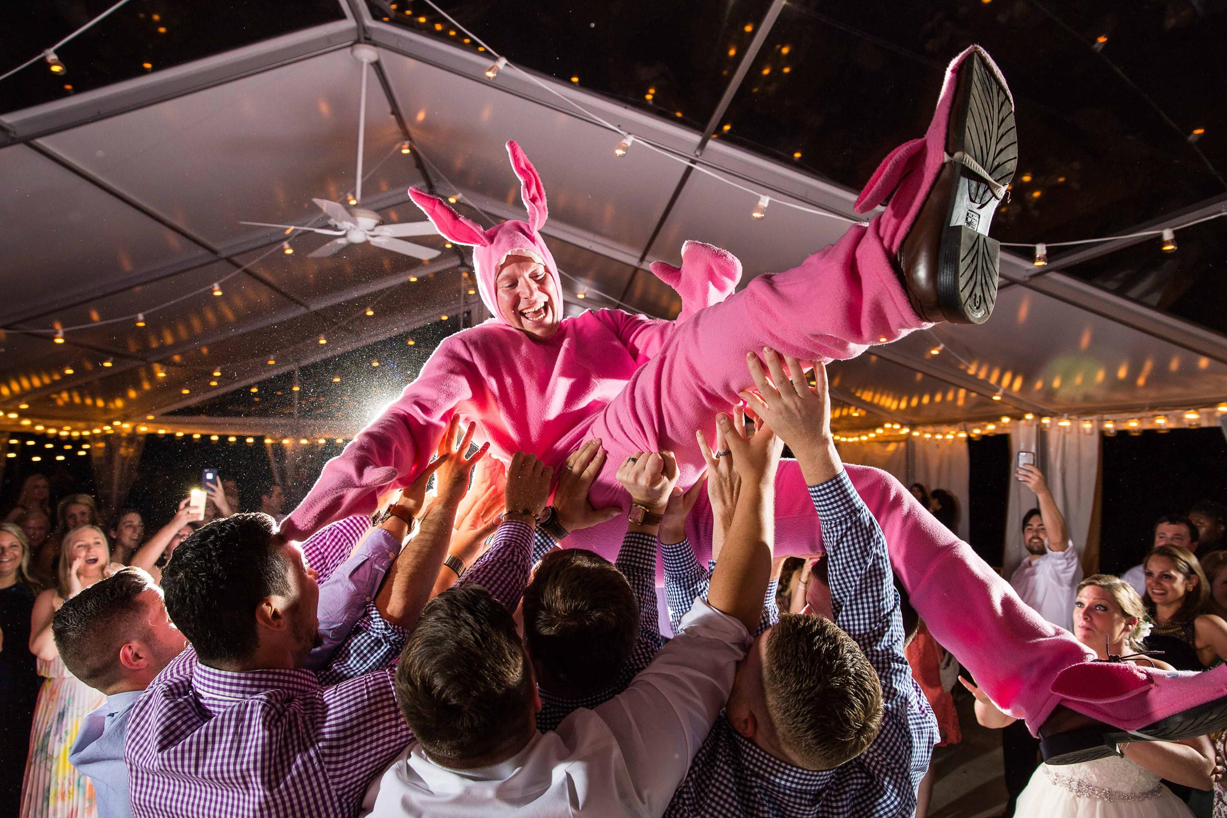 groom-in-pink-bunny-costume-held-aloft-fuller-photography