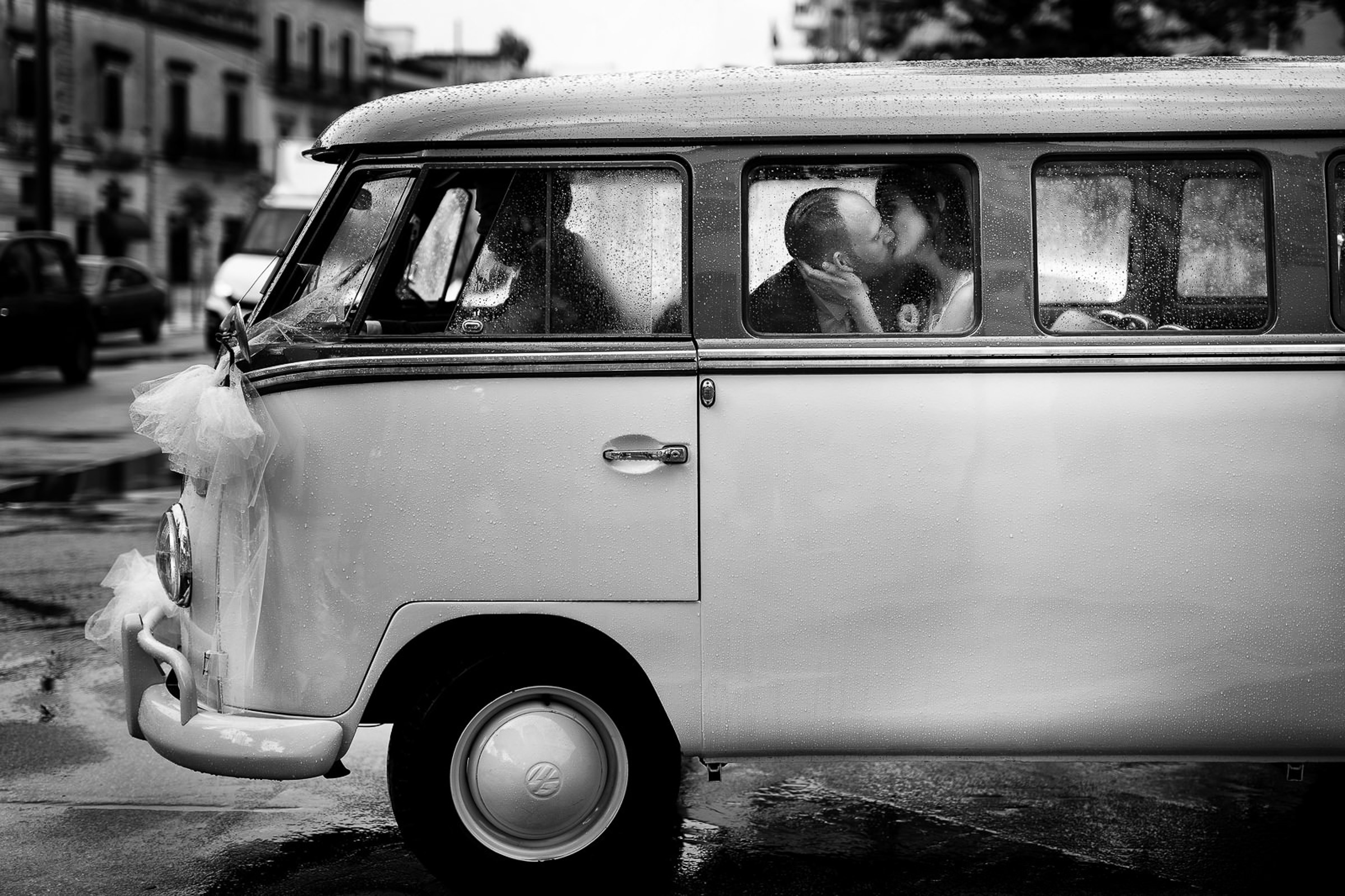 photo-of-wedding-couple-kissing-in-vw-bus-by-rino-cordella-in-puglia-italy
