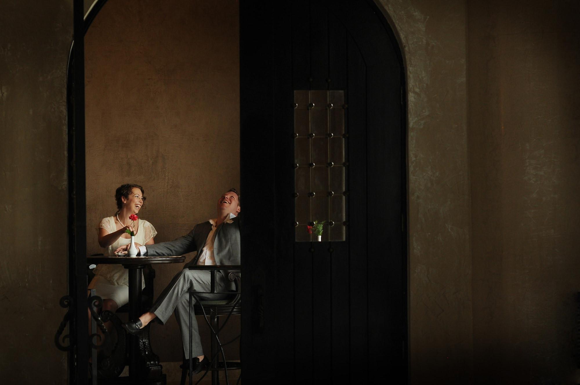 bride-and-groom-laughing-in-doorway-worlds-best-wedding-photos-daniel-aguilar-houston-wedding-photographers