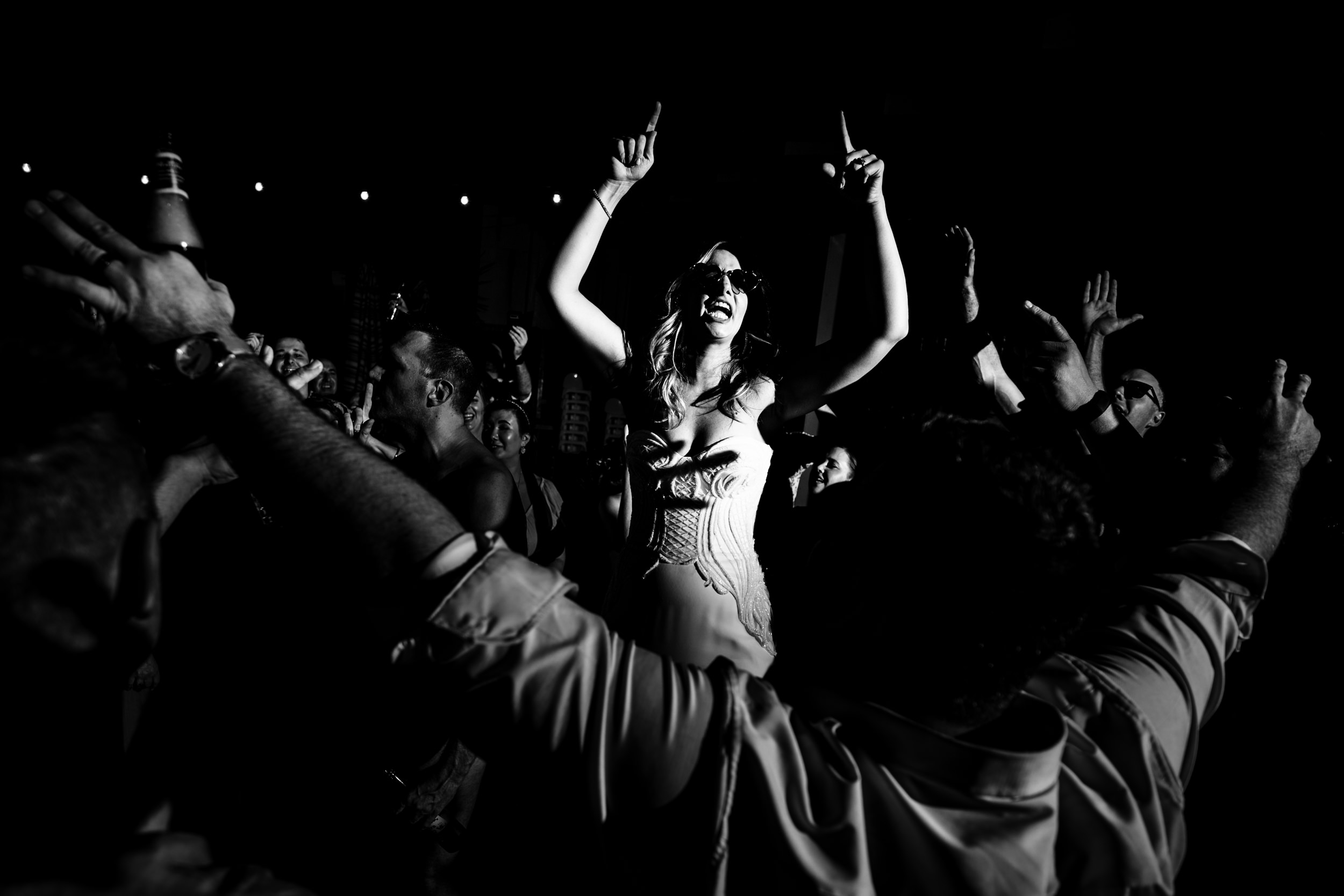 dance-party-bride-wearing-sunglasses-blue-sky-photography