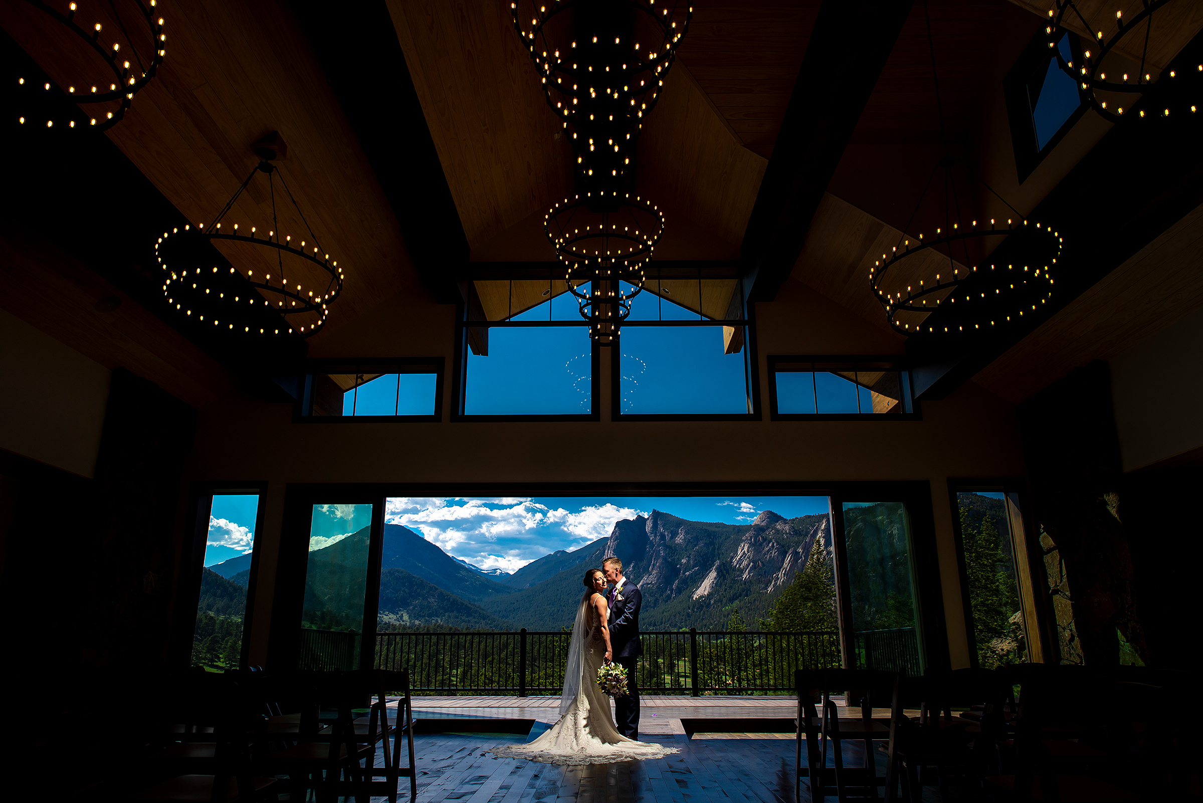mountain-venue-with-couple-framed-by-large-window-with-epic-view-j-la-plante-photo