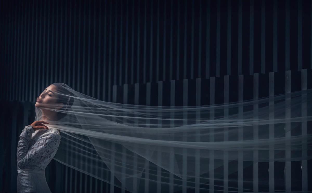 Romantic portrait of bride with long veil by CM Leung