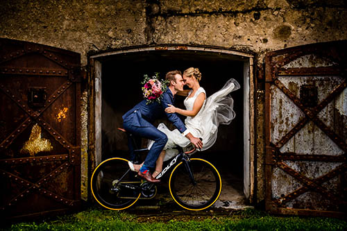 Bride and groom on a bicycle - photo by Eppel Photography