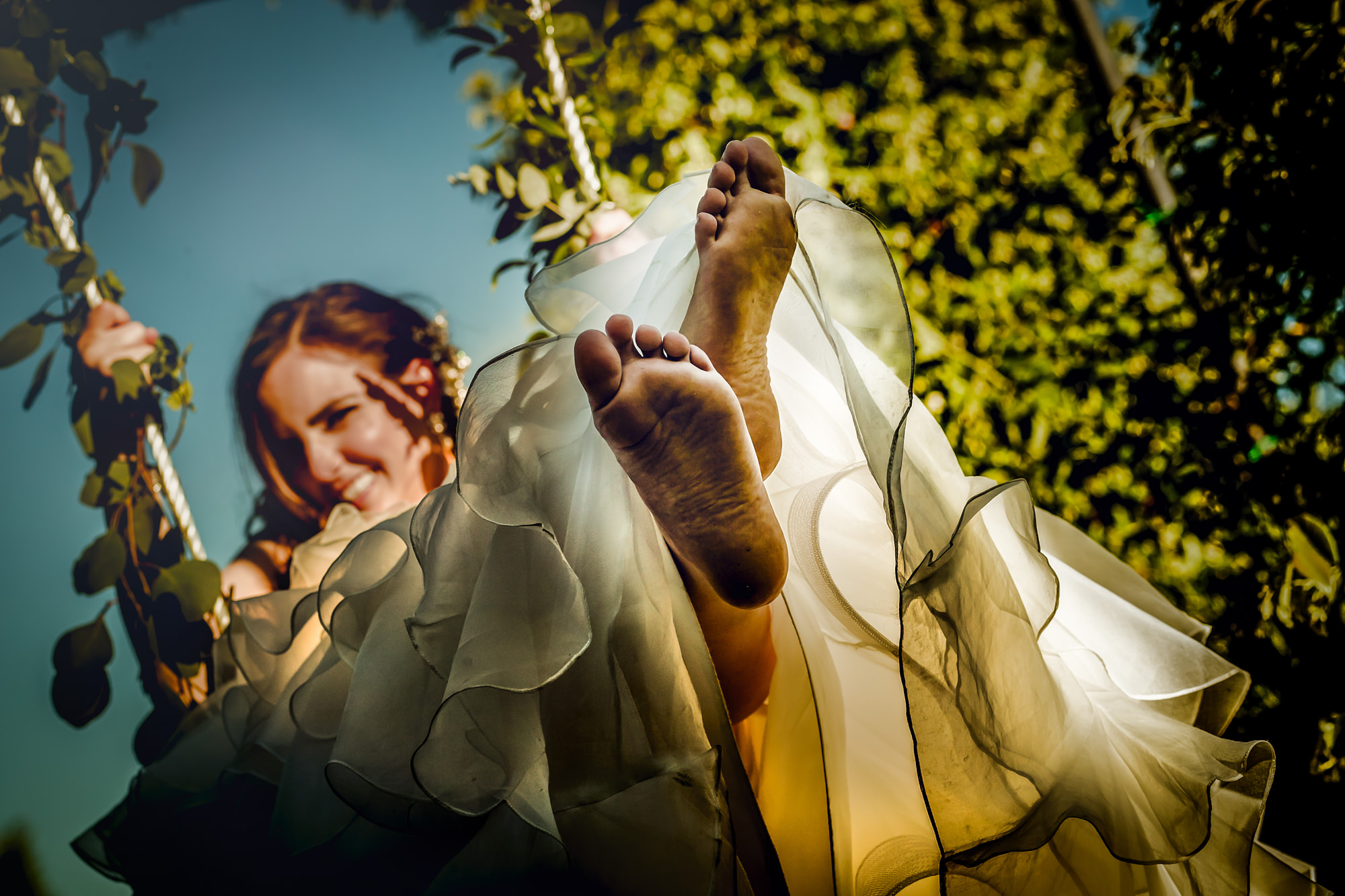 Creative composition of bride on swing - Photo by Eppel Photography