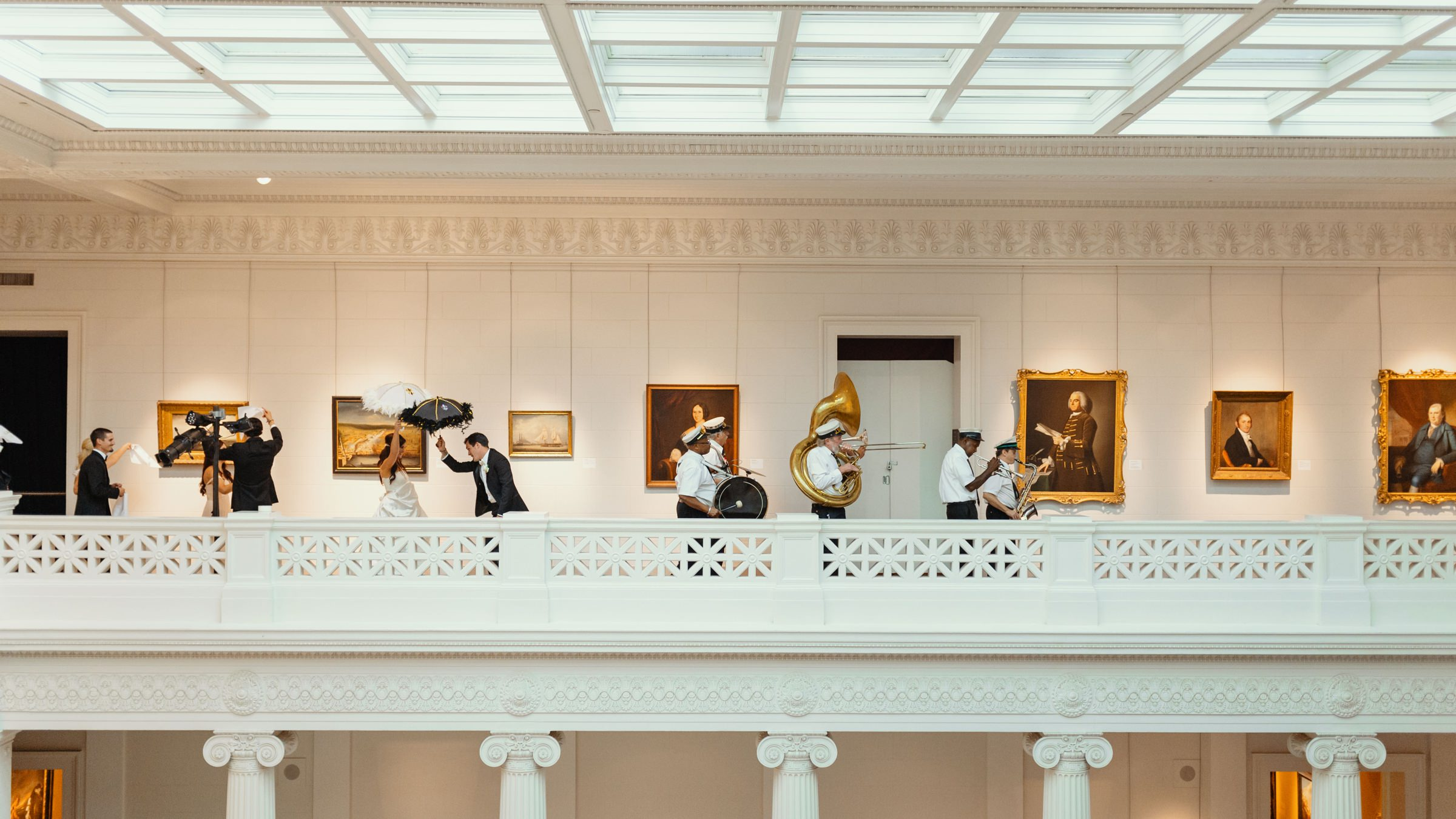 couple-with-brass-band-marching-through-museum-dark-roux
