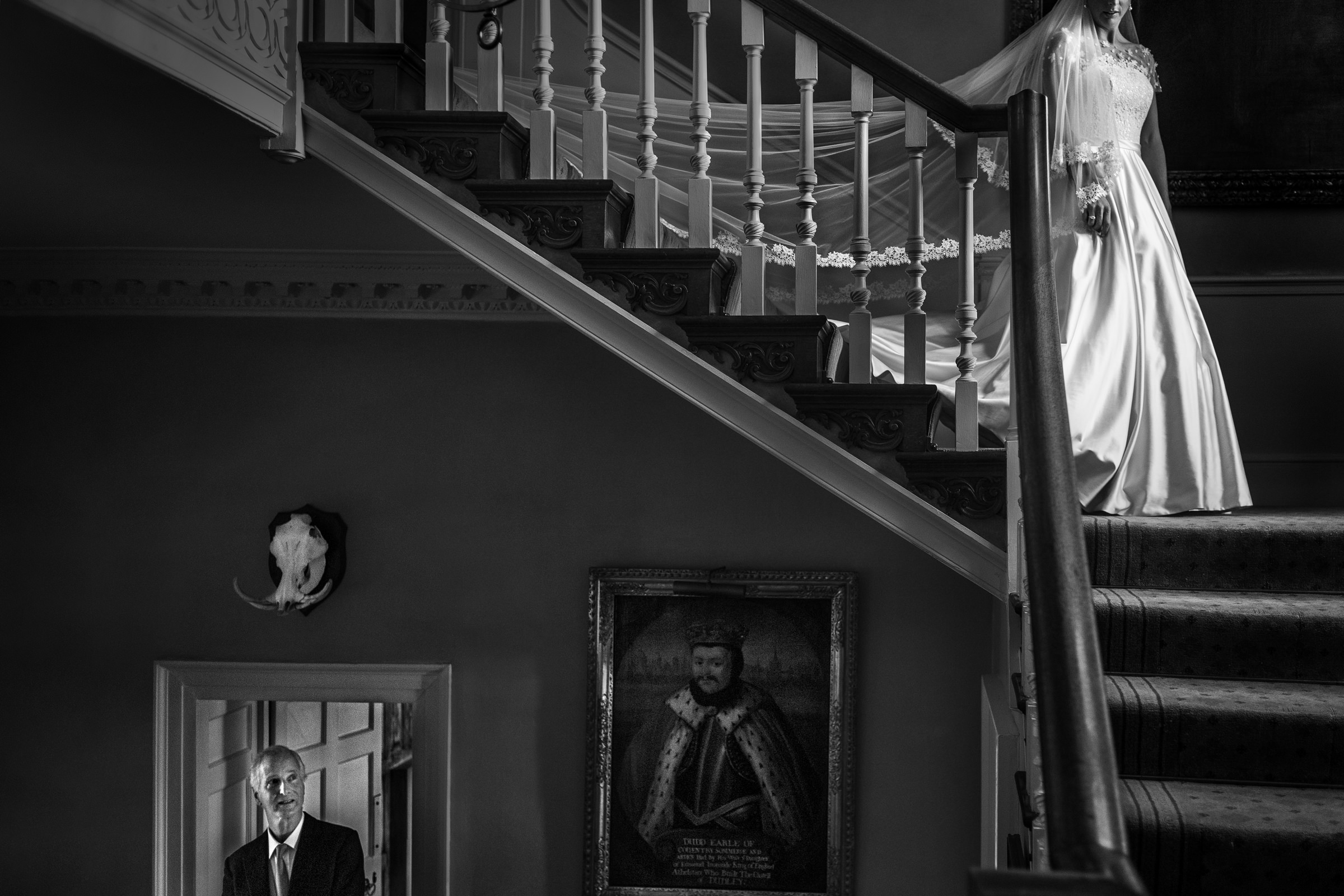 creative-composition-of-bride-descending-stairs-for-first-look-worlds-best-wedding-photos-victor-lax