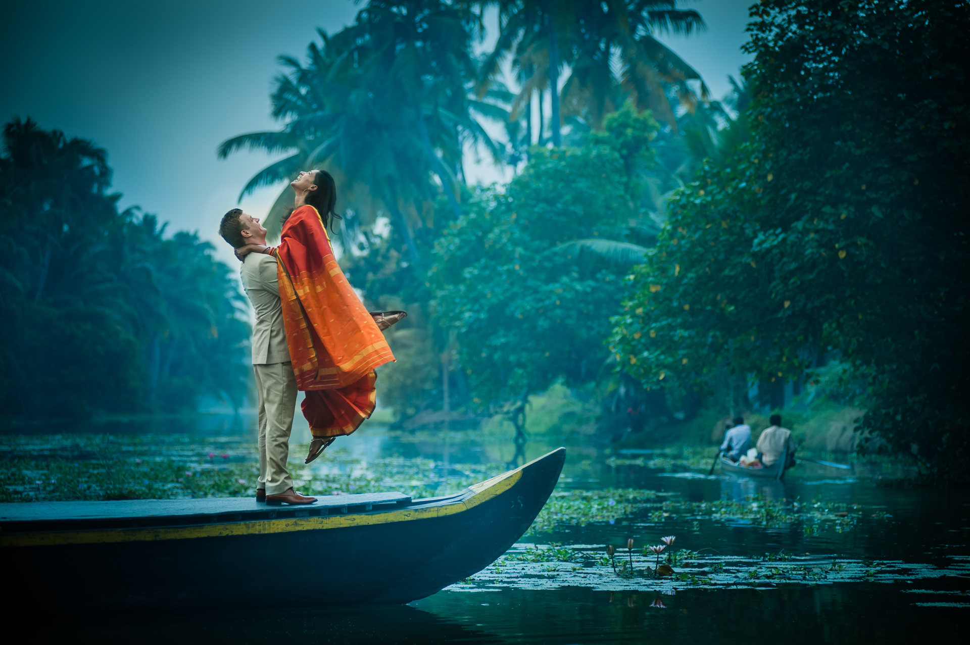 Estatic groom in East Indian attire lifting his joyful bride photographed by Sephi Bergerson