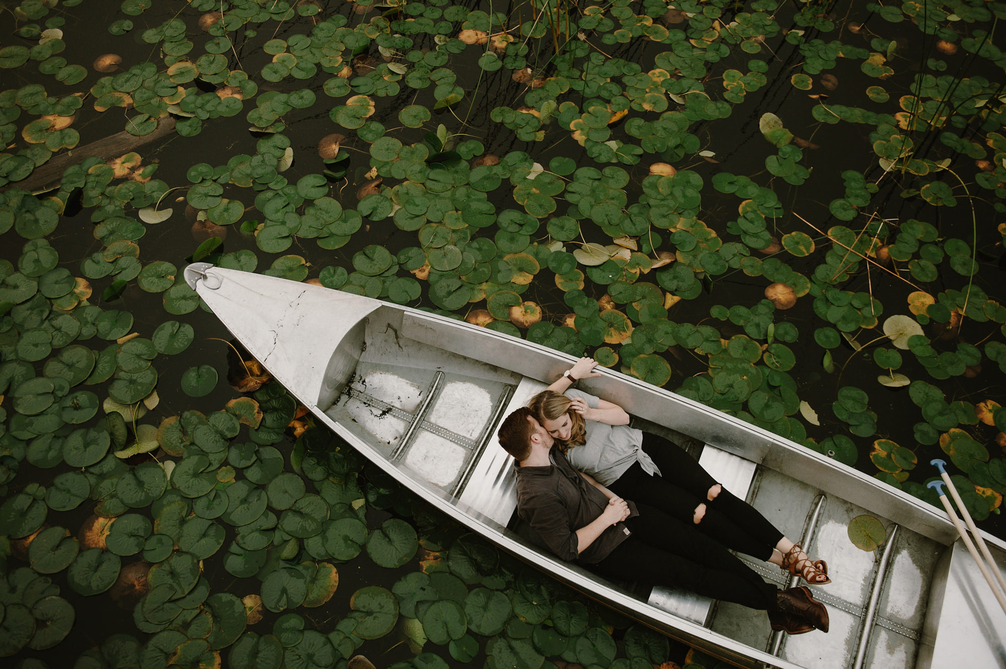 engagement-photos-couple-in-canoe-from-above-worlds-best-wedding-photographers-kristen-marie-parker-seattle-wedding-photographers