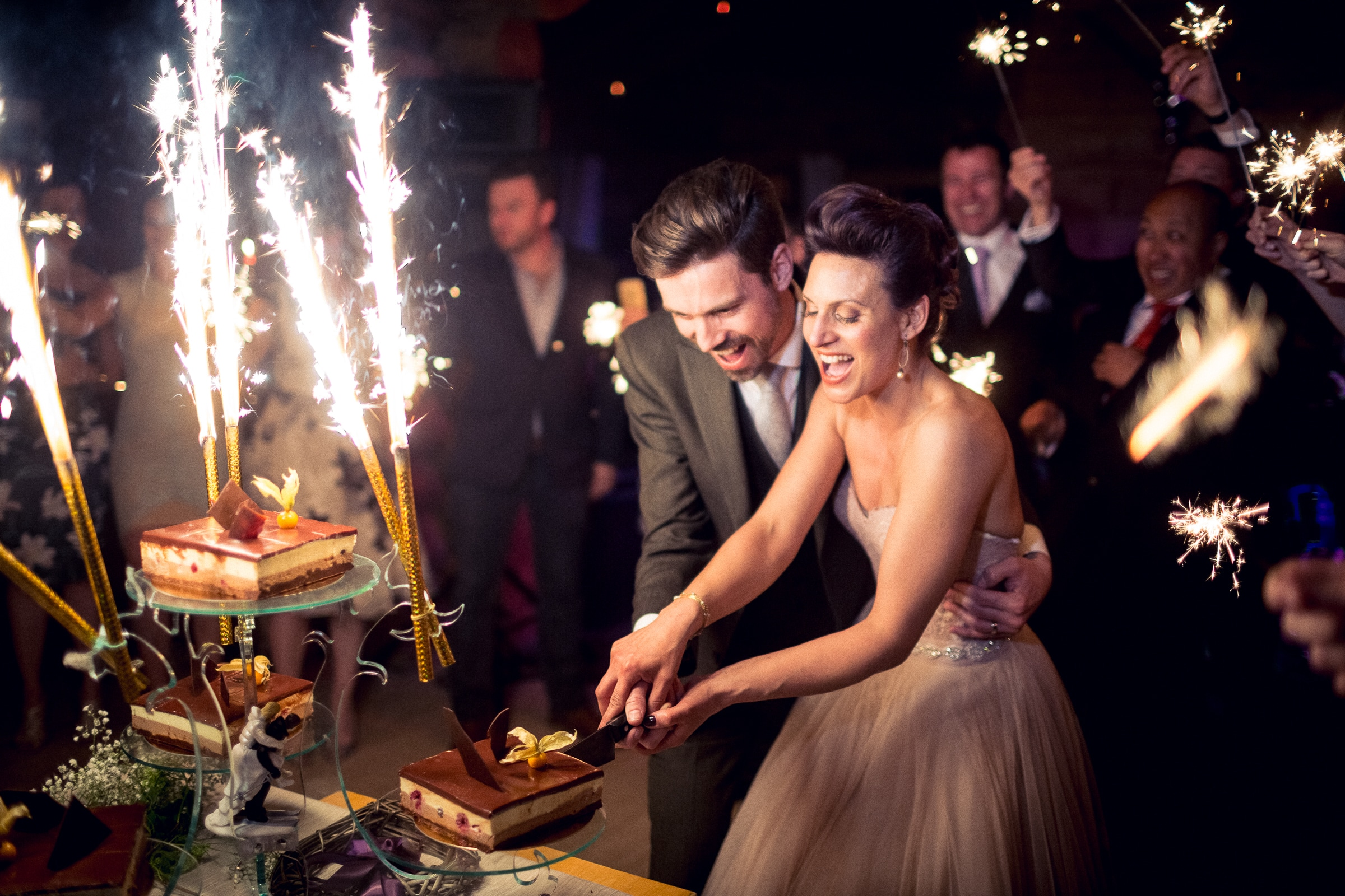 french-couple-cuts-cream-cakes-with-sparklers-sylvain-bouzat