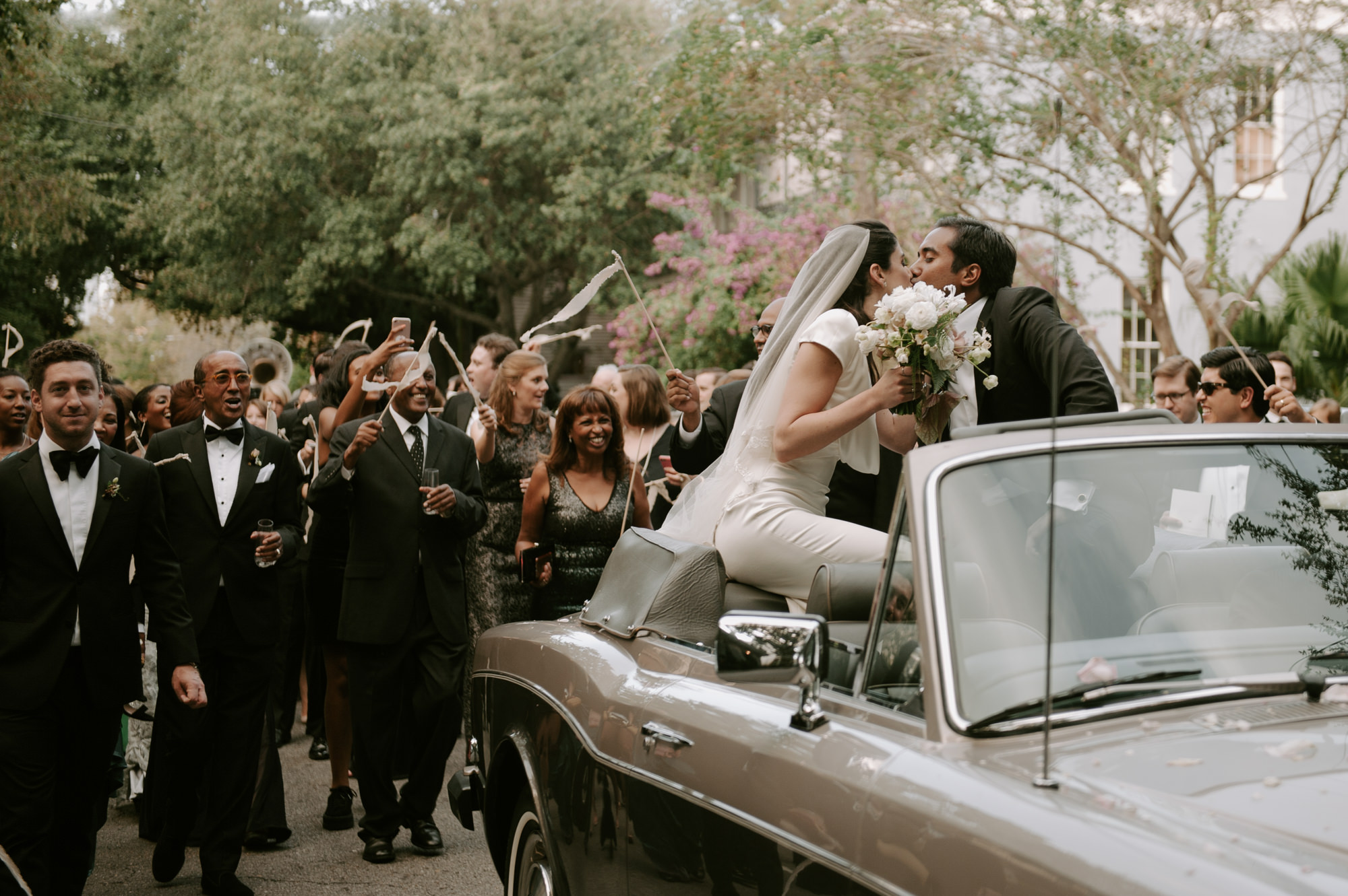 Just married couple in celebration parade - photo by Kristen Marie Parker