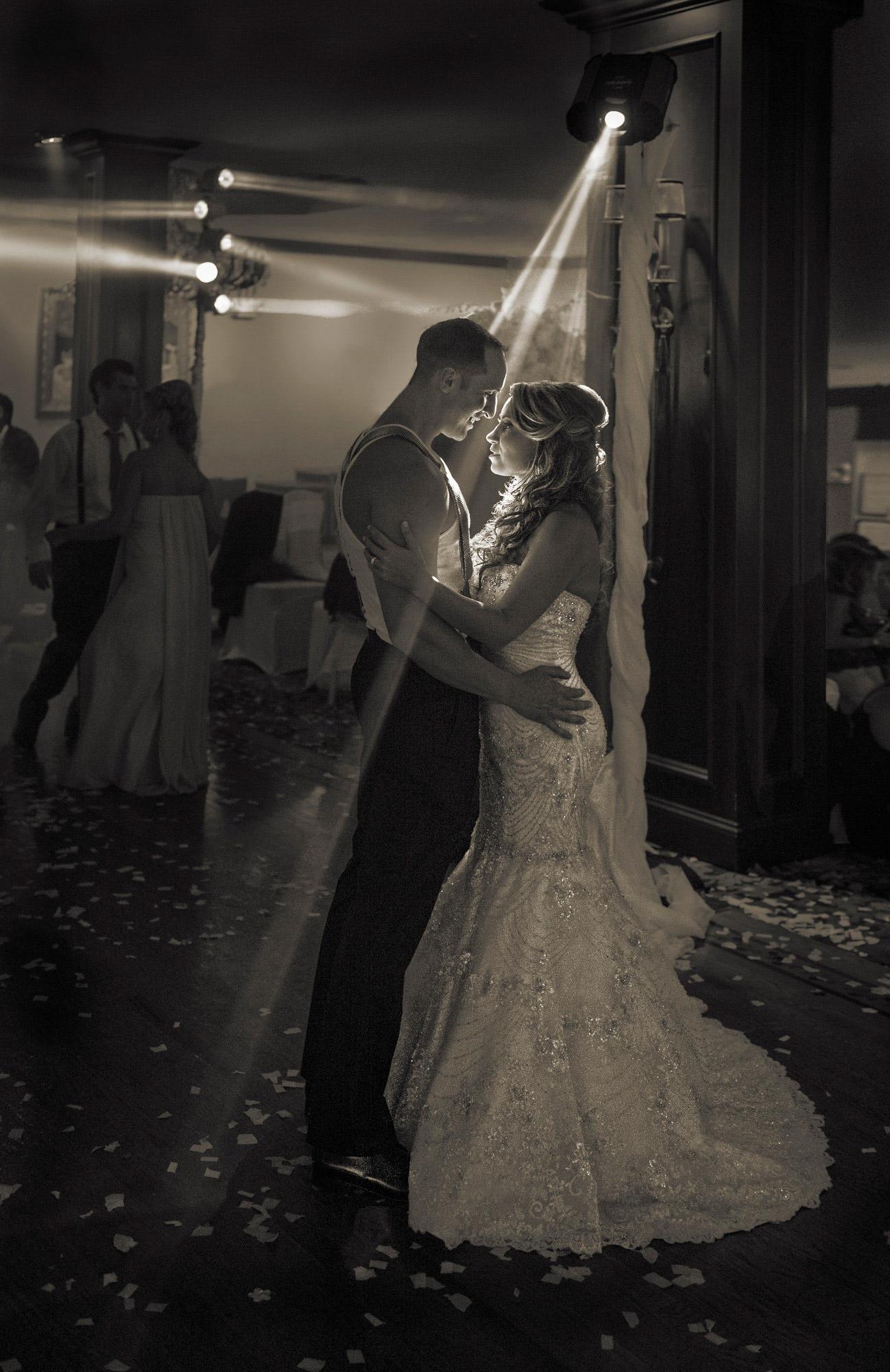 spotlit-bride-dances-with-shirtless-groom-in-suspenders-best-wedding-photos-jerry-ghionis-top-las-vegas-photographer