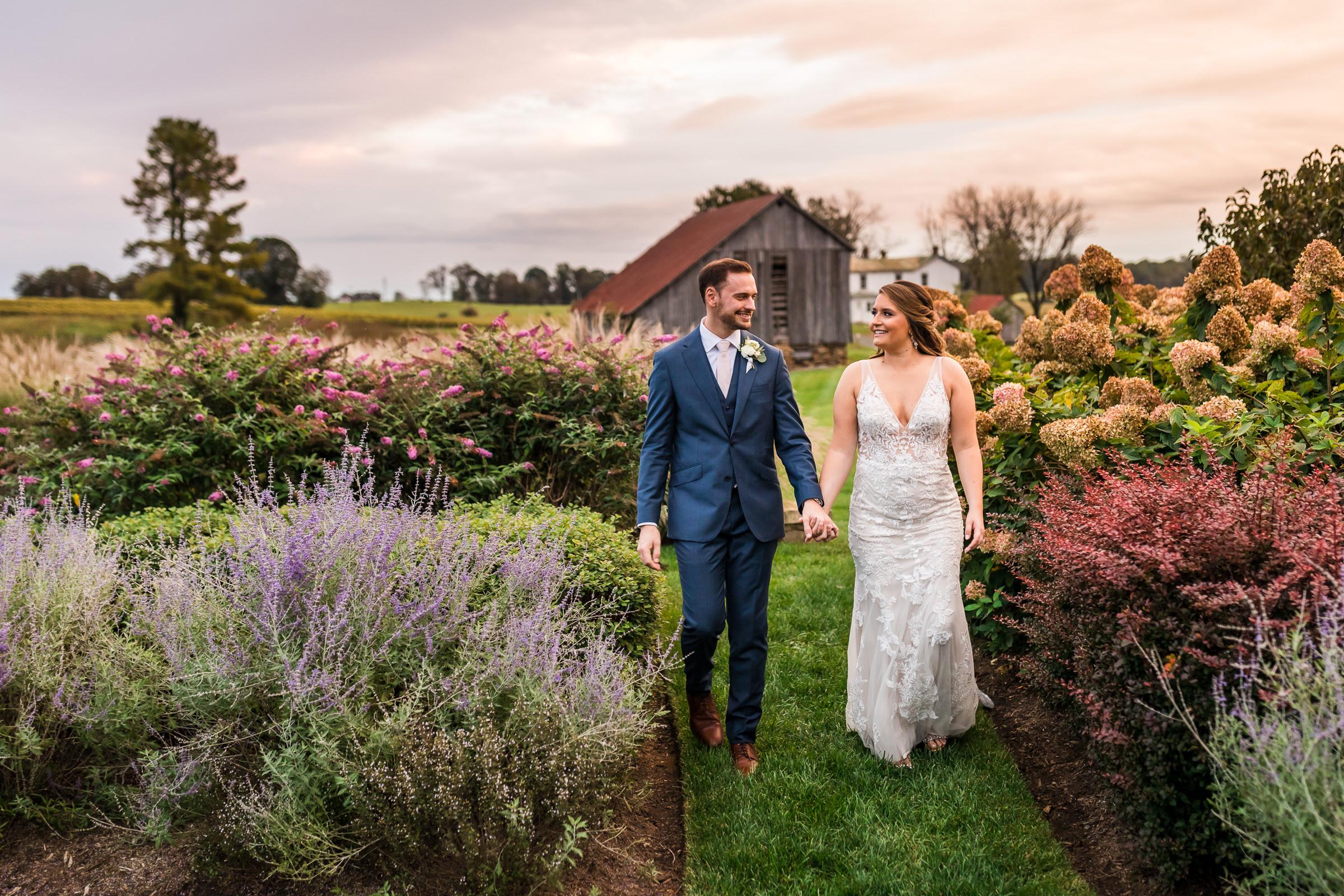 couple-walks-hand-in-hand-in-garden-xiaoqi-li-photography