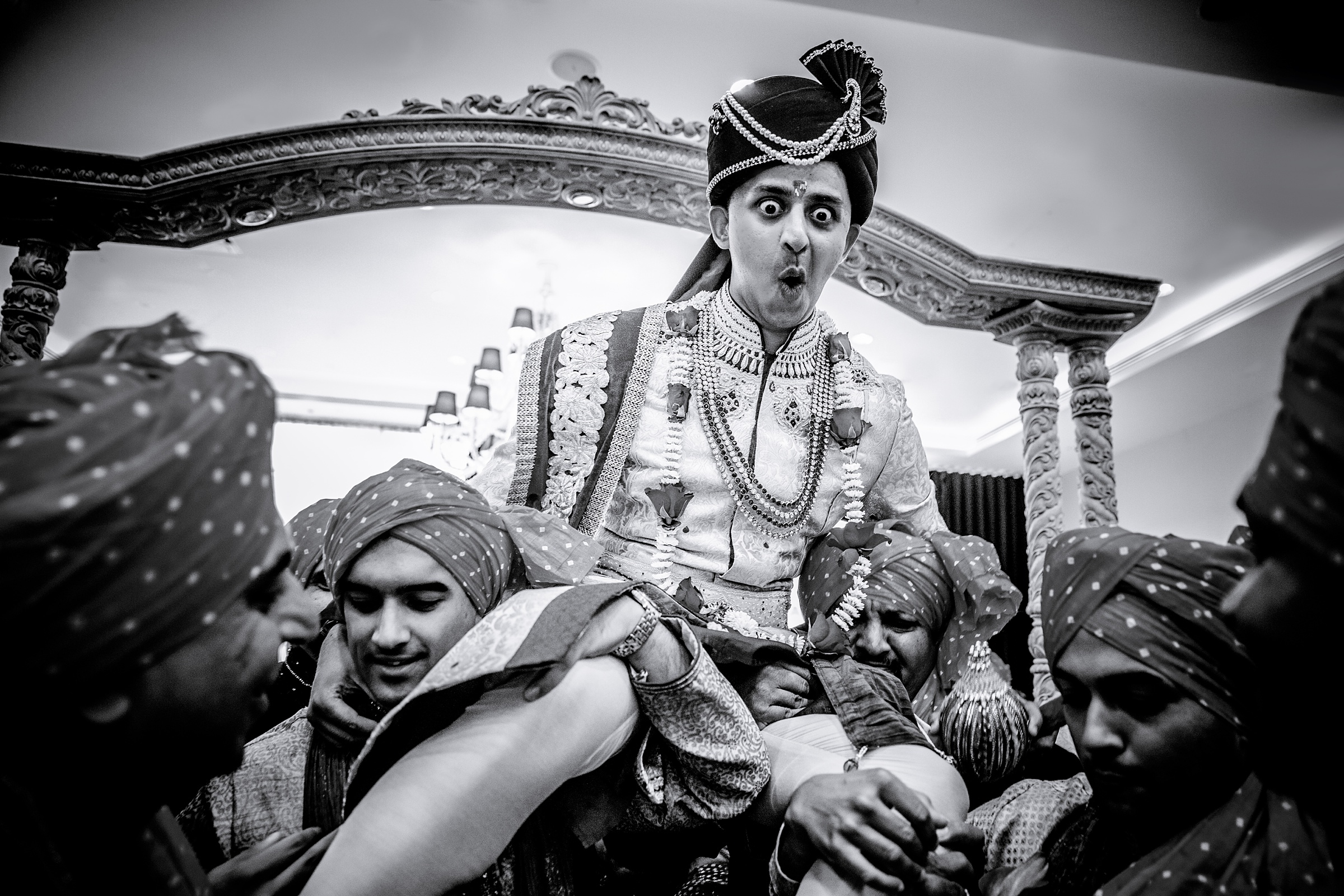 groom-makes-funny-face-as-he-is-carried-aloft-apresh-chavda-photography