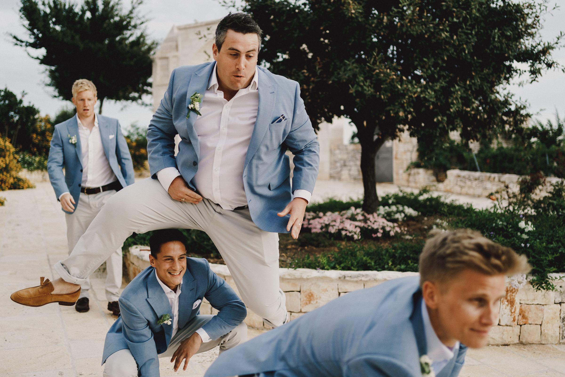 groomsmen-playing-leapfrog-miki-studios