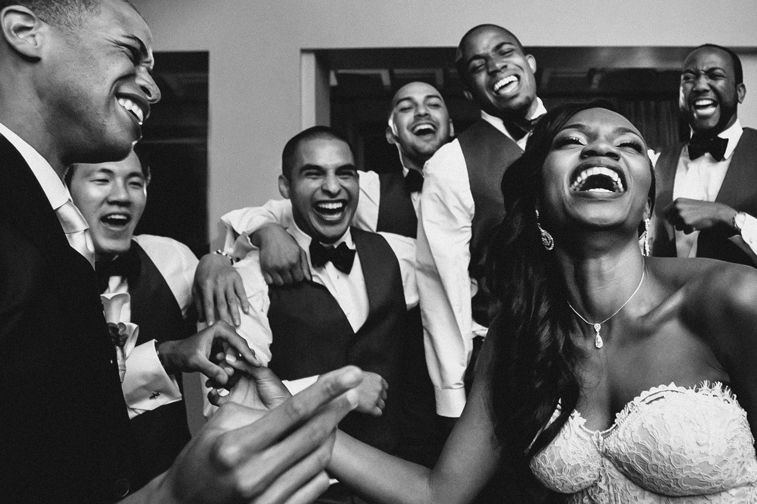 Joyous bride celebrates with groom and groomsmen - photographed by Callaway Gable