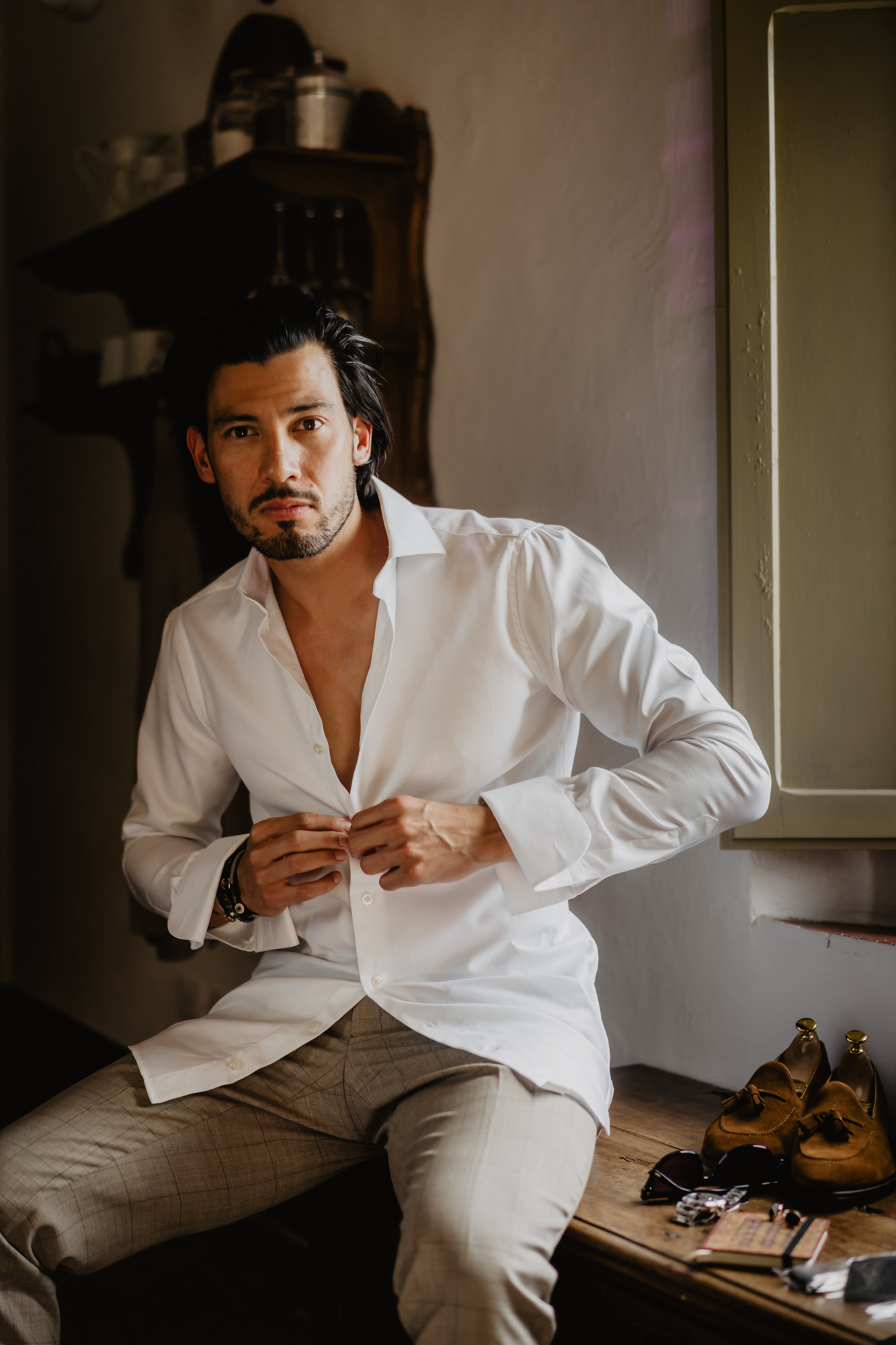 italian-groom-gets-ready-white-dress-shirt-checked-taupe-silk-pants-worlds-best-wedding-photos-david-bastianoni-italy-wedding-photographers