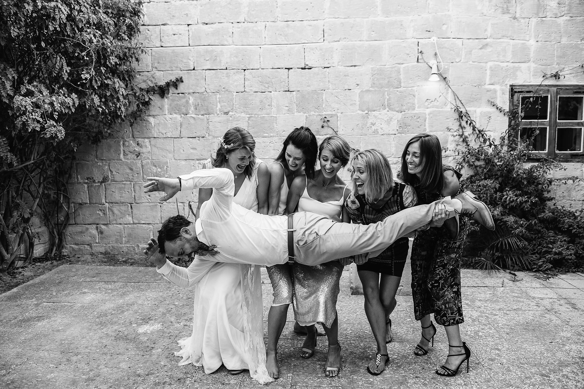 bride-and-her-friends-having-fun-with-the-groom-photo-by-shane-p-watts-photography
