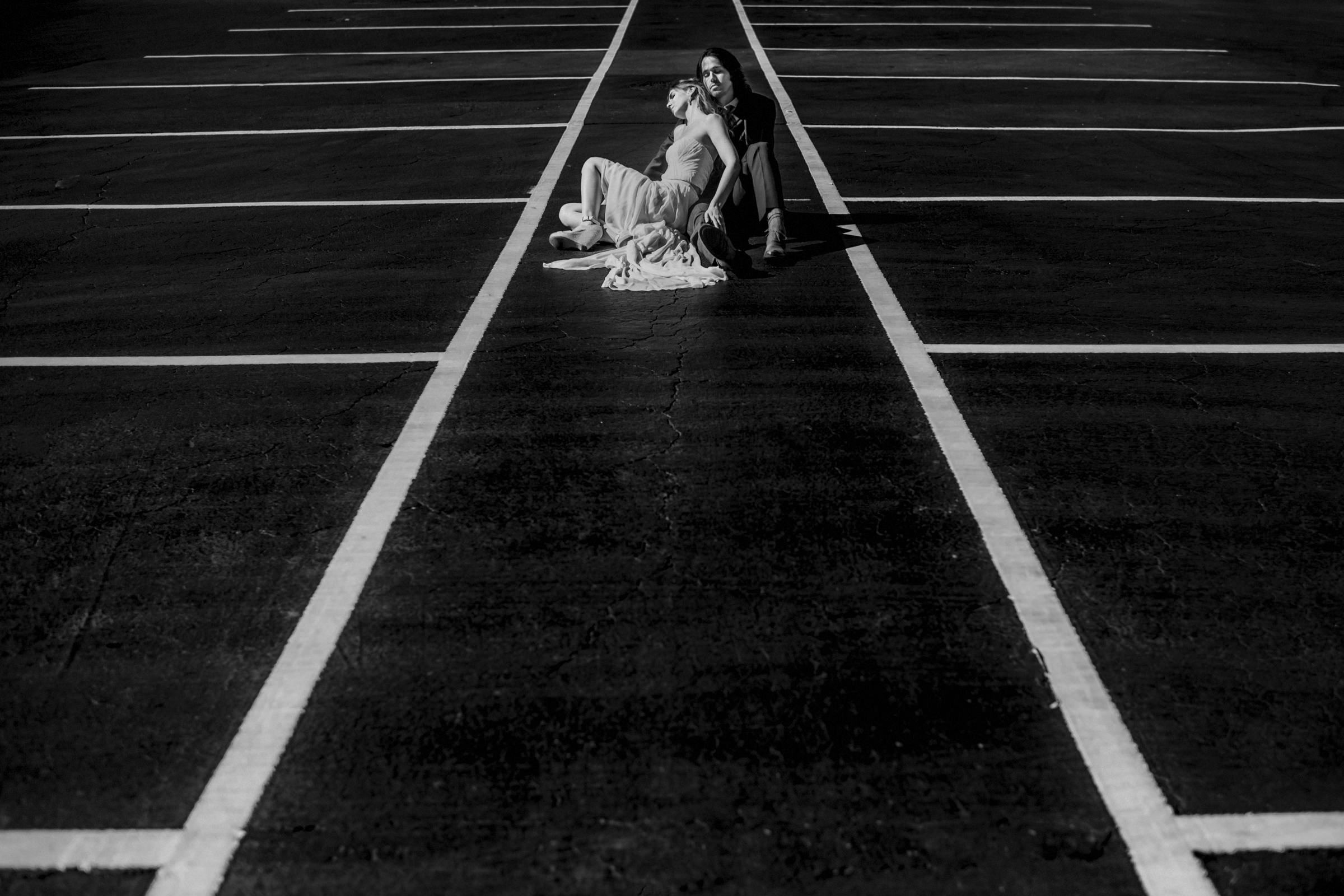 creative-compositon-of-couple-in-parking-lot-marcorojo-best-wedding-photographers-spain