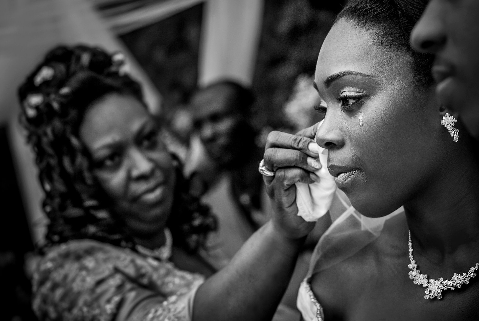 featured-black-and-white-mom-of-bride-wiping-tears-on-bride-worlds-best-wedding-photos-davina-plus-daniel-canada
