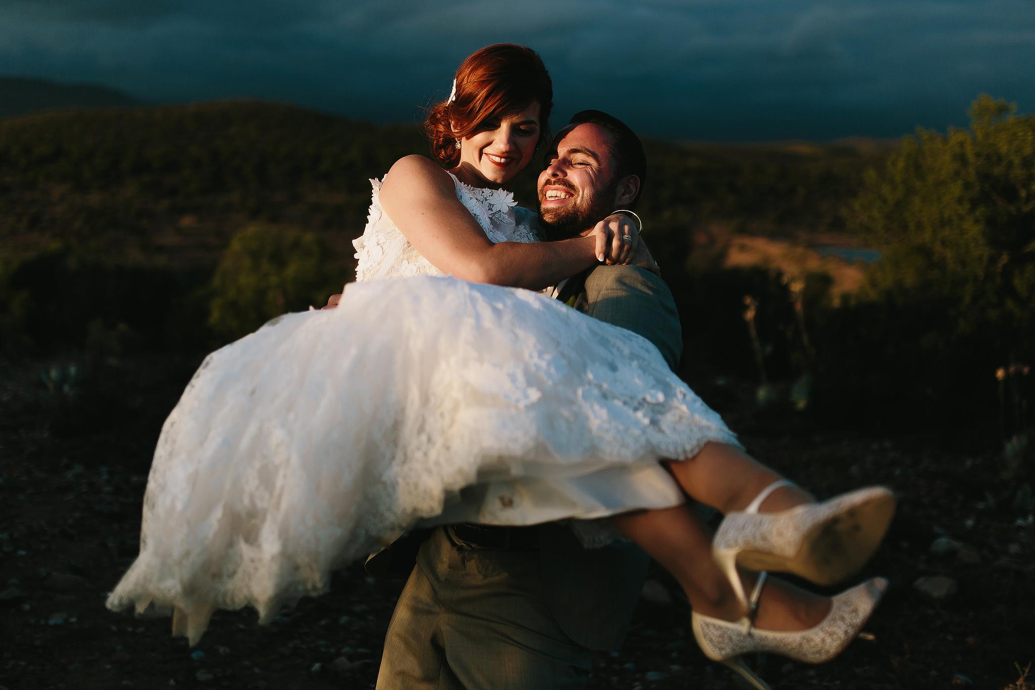groom-carries-bride-outdoors-ruan-redelinghuys-photography