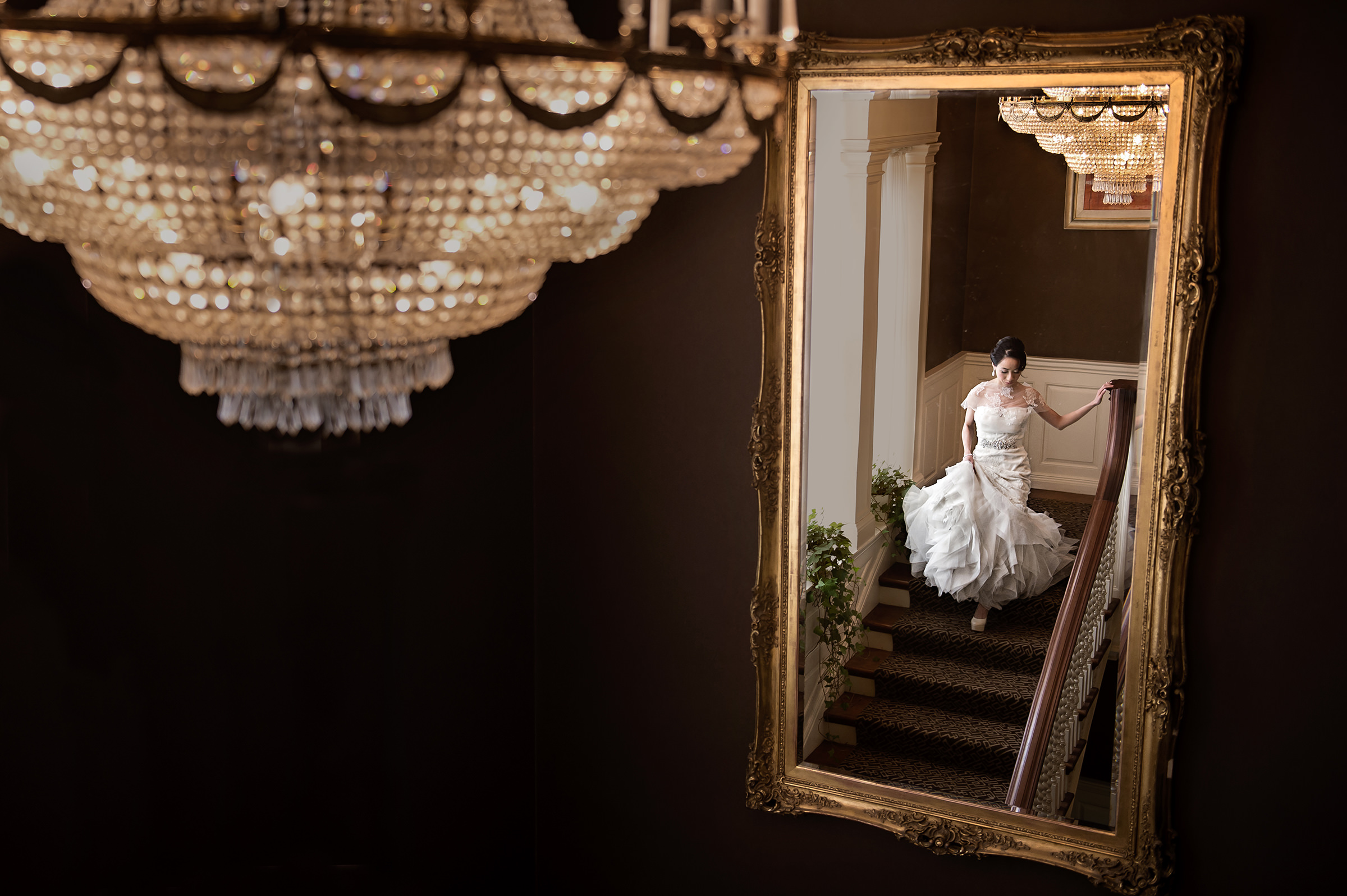 reflected-bride-in-trumpet-gown-descending-staircase-david-sherry-photography