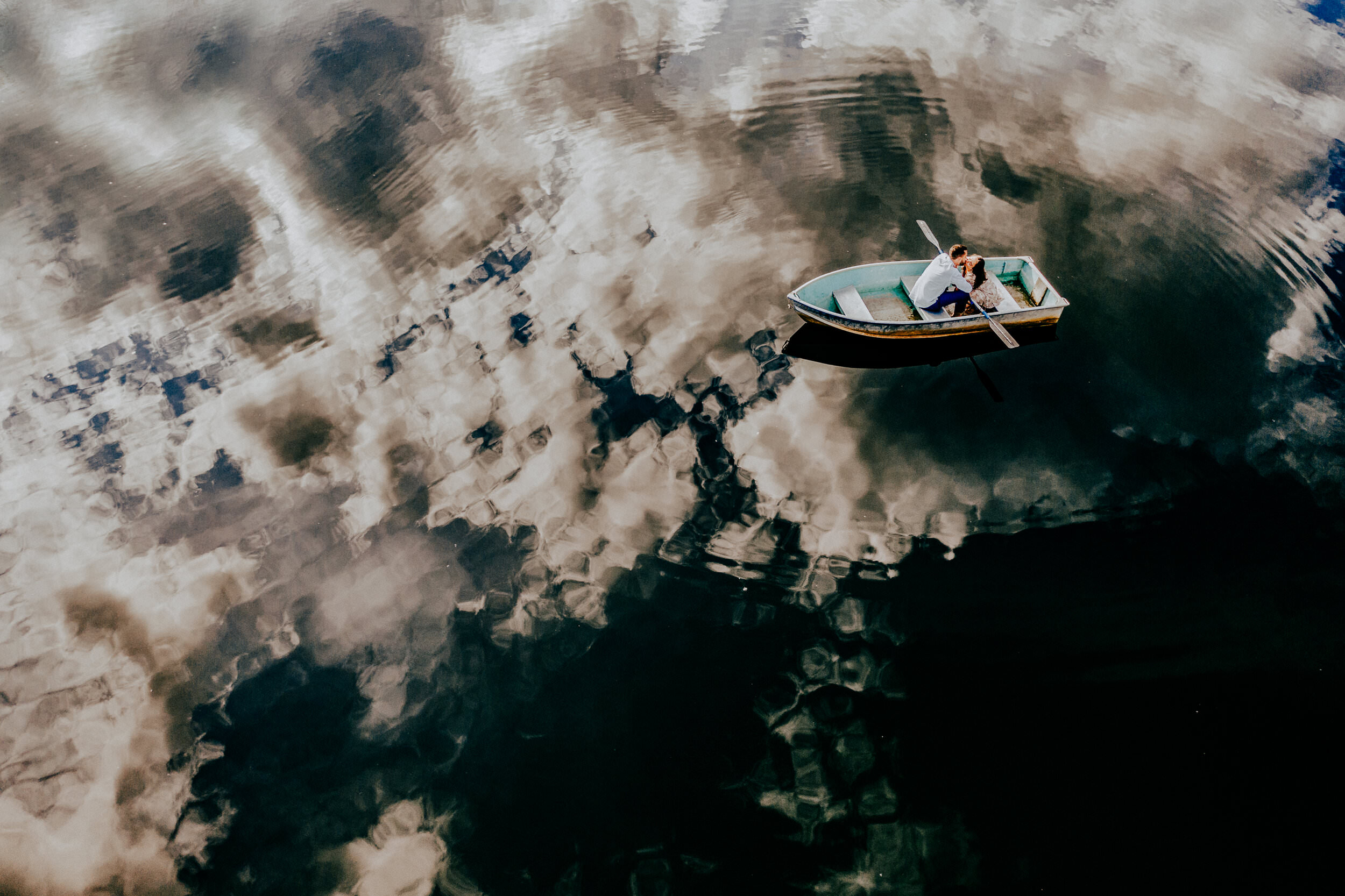 couple-in-rowboat-surrounded-by-cloud-reflection-esteban-gil-photography-north-carolina