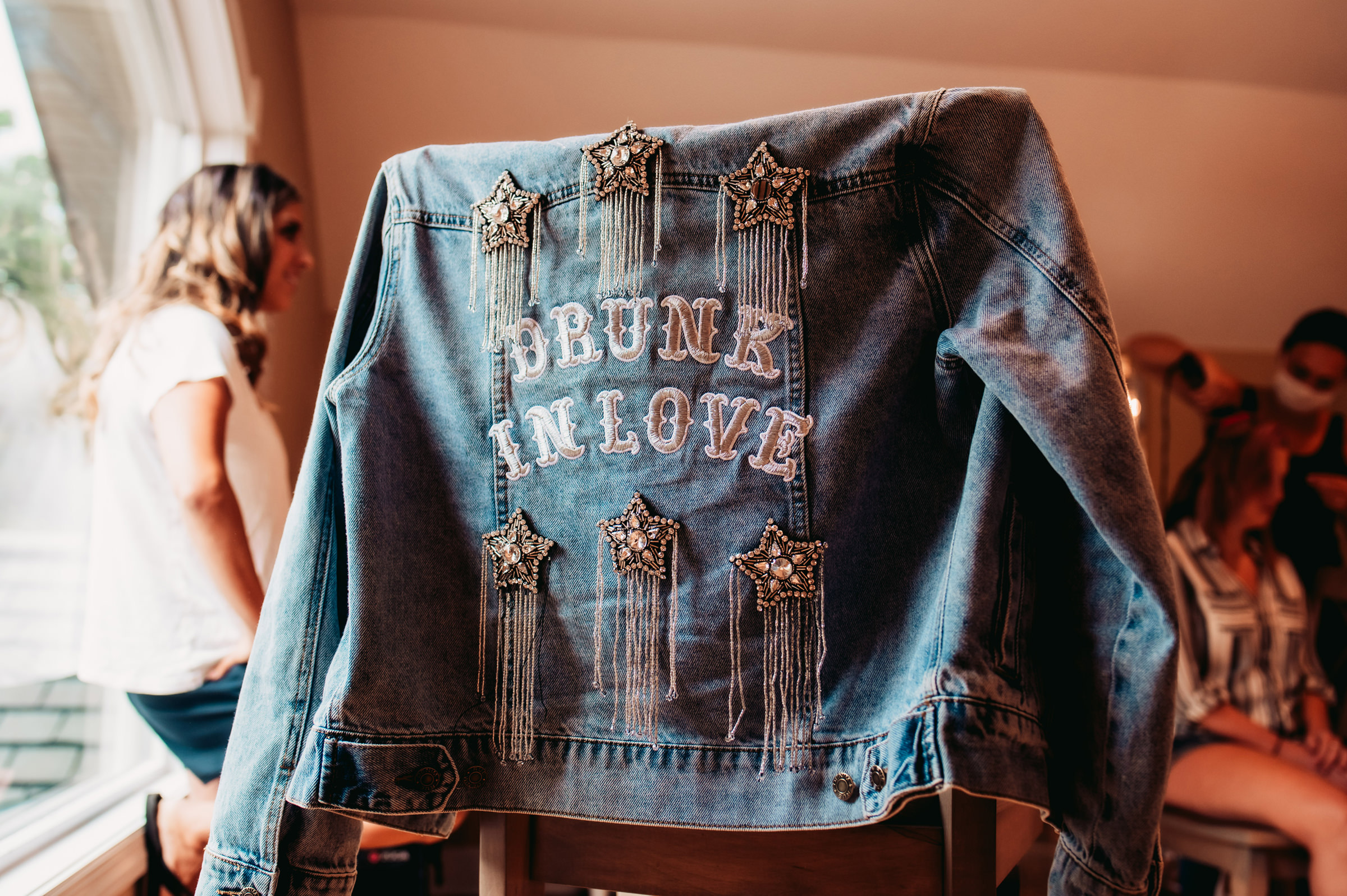 denim-jacket-on-chair-with-lettering-drunk-in-love-mike-zawadzki-photography