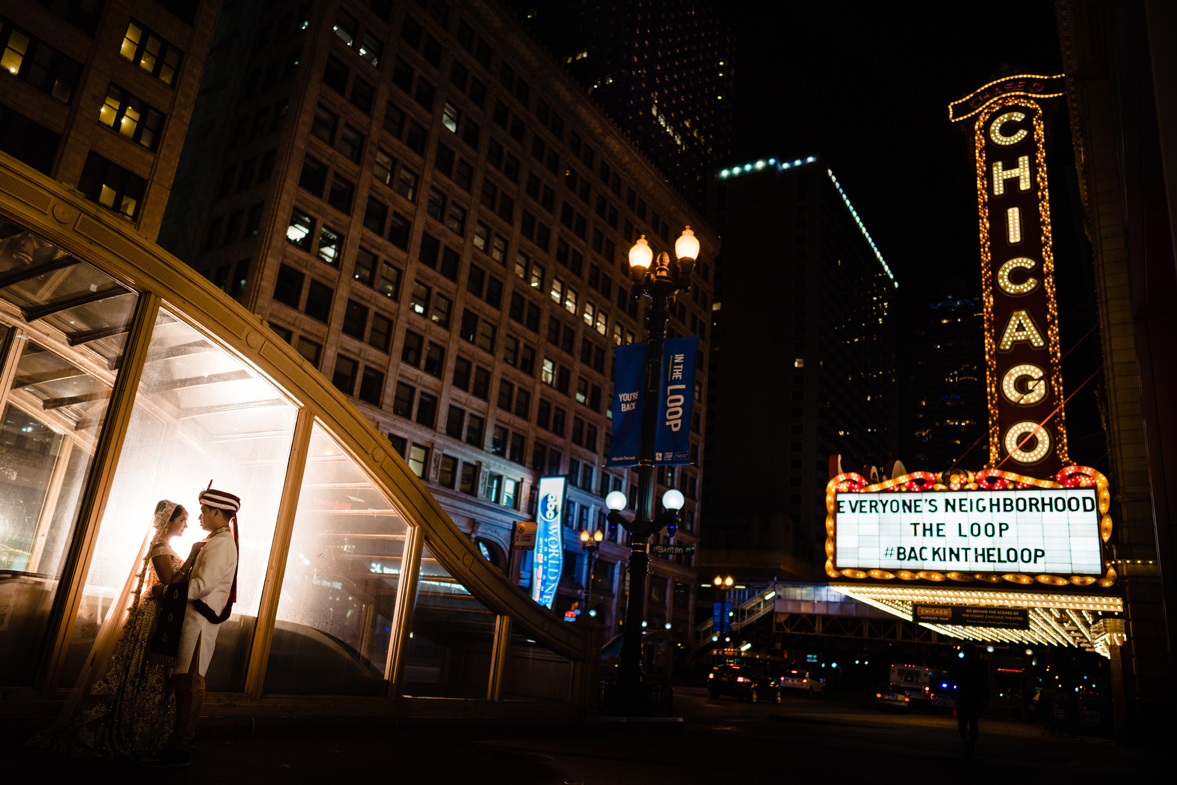indian-couple-at-theater-with-lighted-chicago-marquis-vinson-images