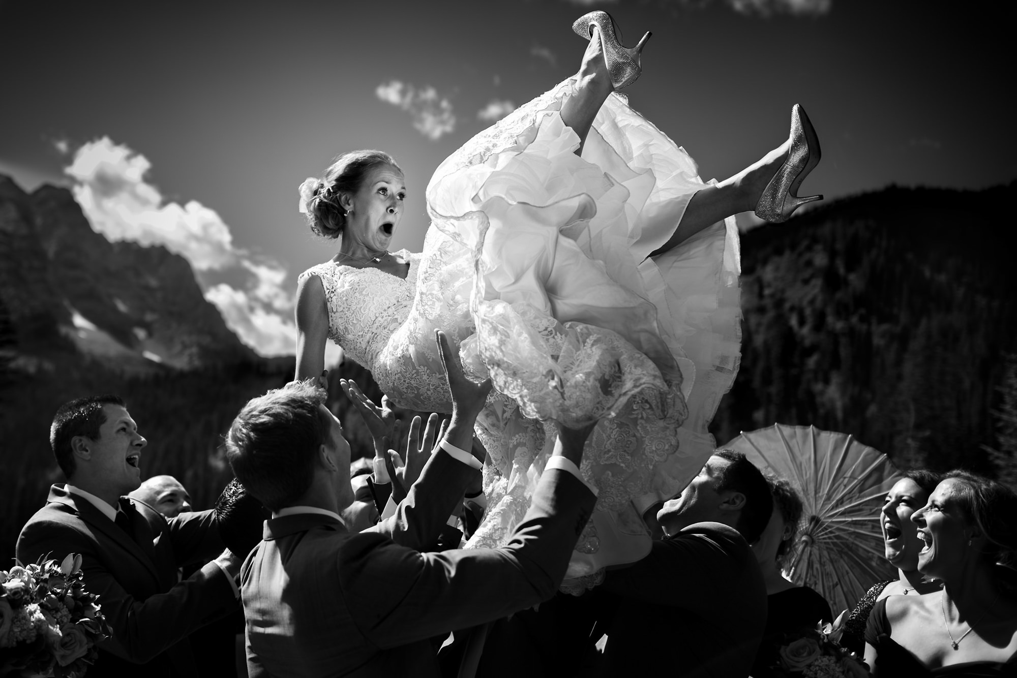 Bride being carried in the air by groomsmen - photo by Two Mann Studios