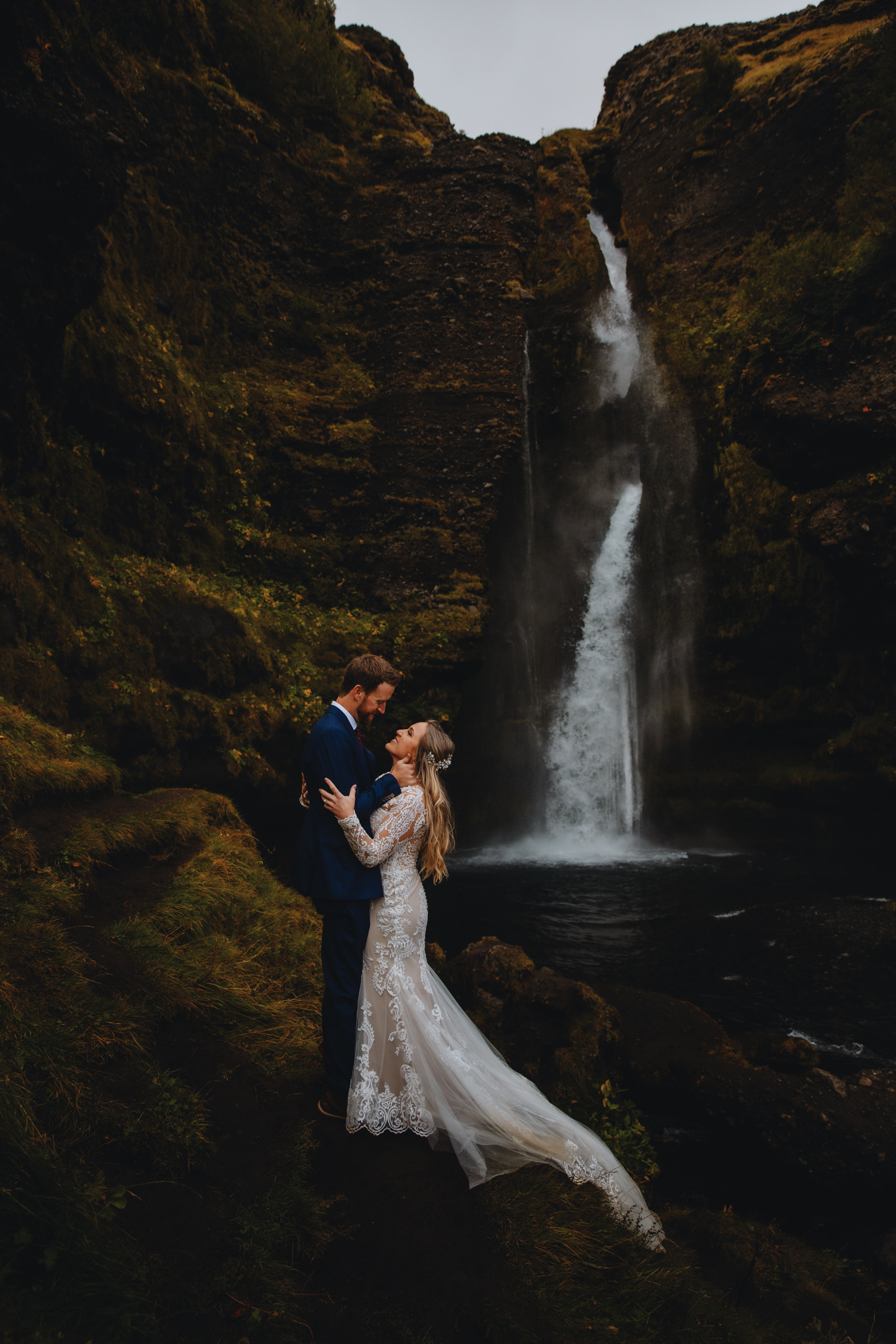 Portrait at secret waterfall in Iceland by Christin Eide