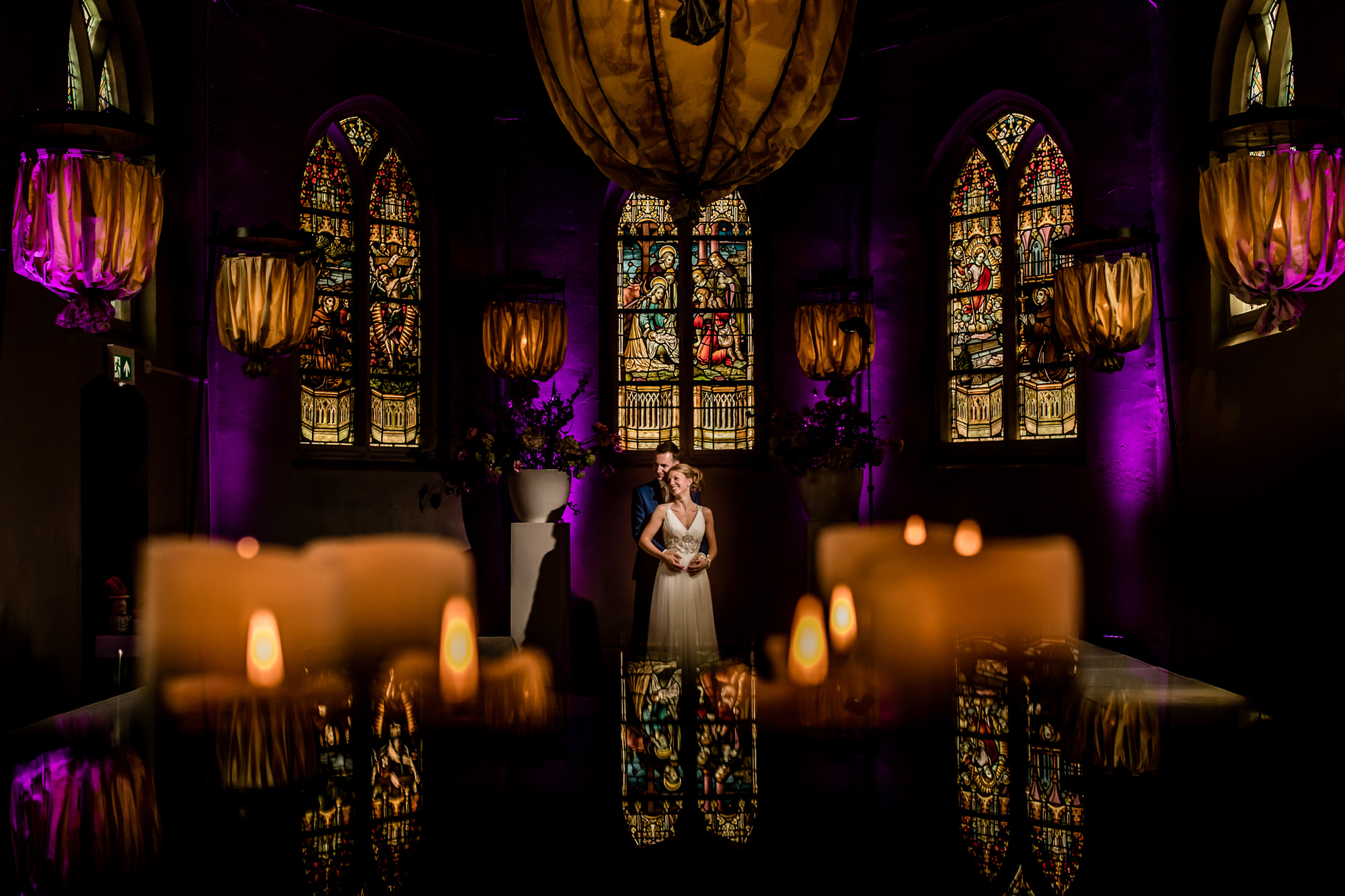 Couple in candlelit stained glass church - photo by Eppel Photography - Weert, Netherlands
