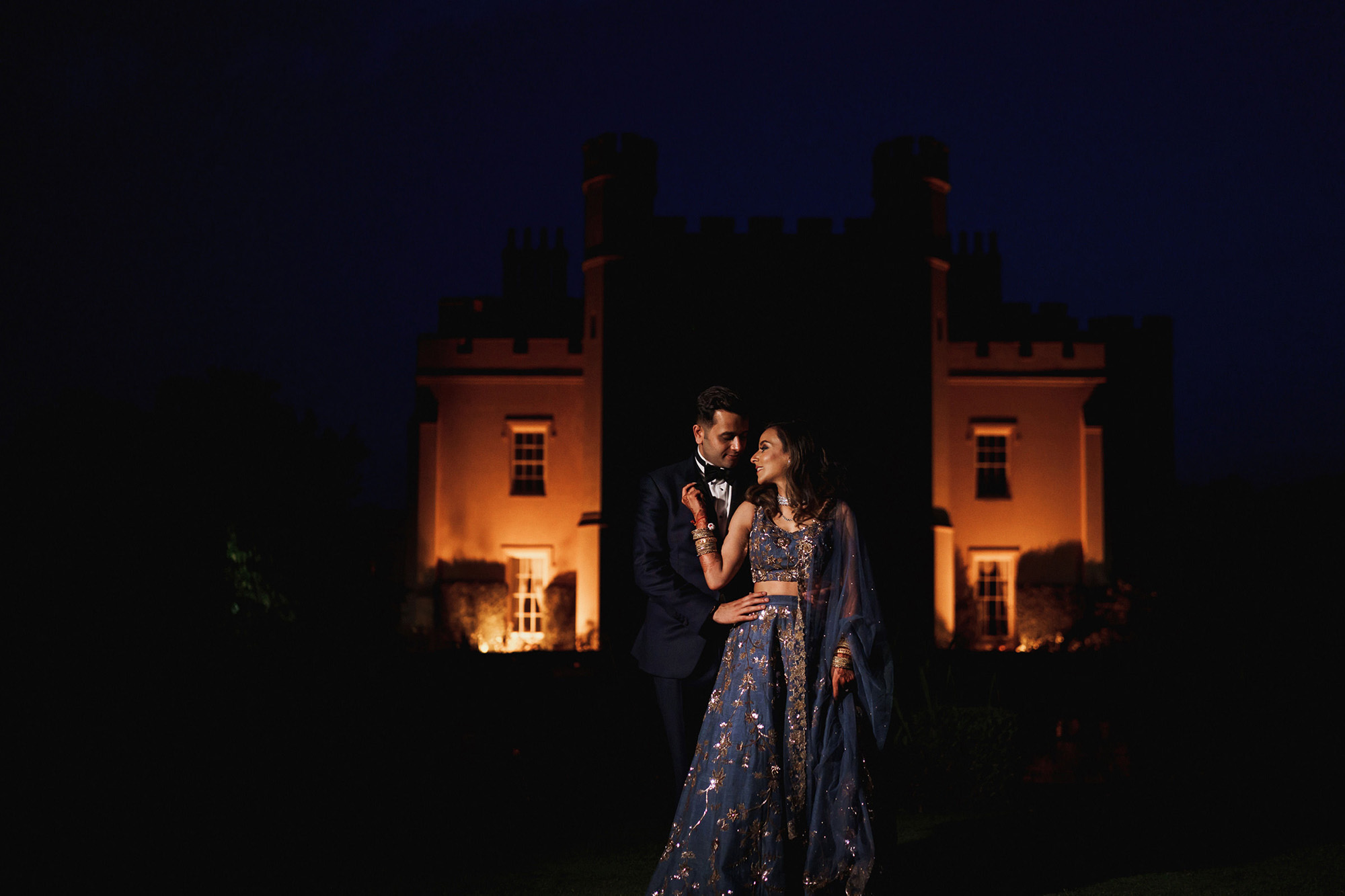 Nighttime portrait of bride and groom at Ditton Manor, Berkshire, England, by Rahul Khona F5