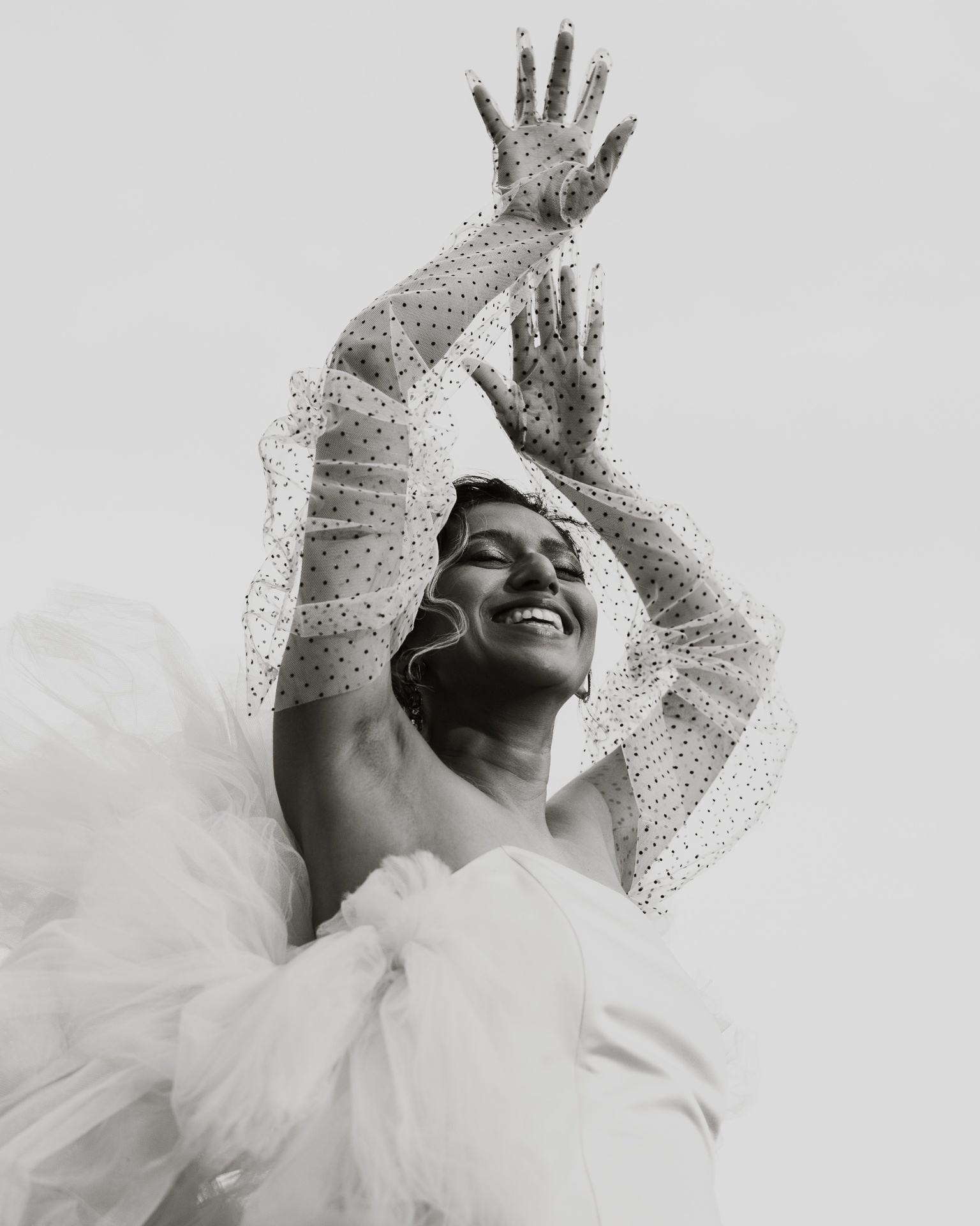 Ecstatic bride with hands above her head photographed by Joel and Justyna - Ottawa wedding photographers