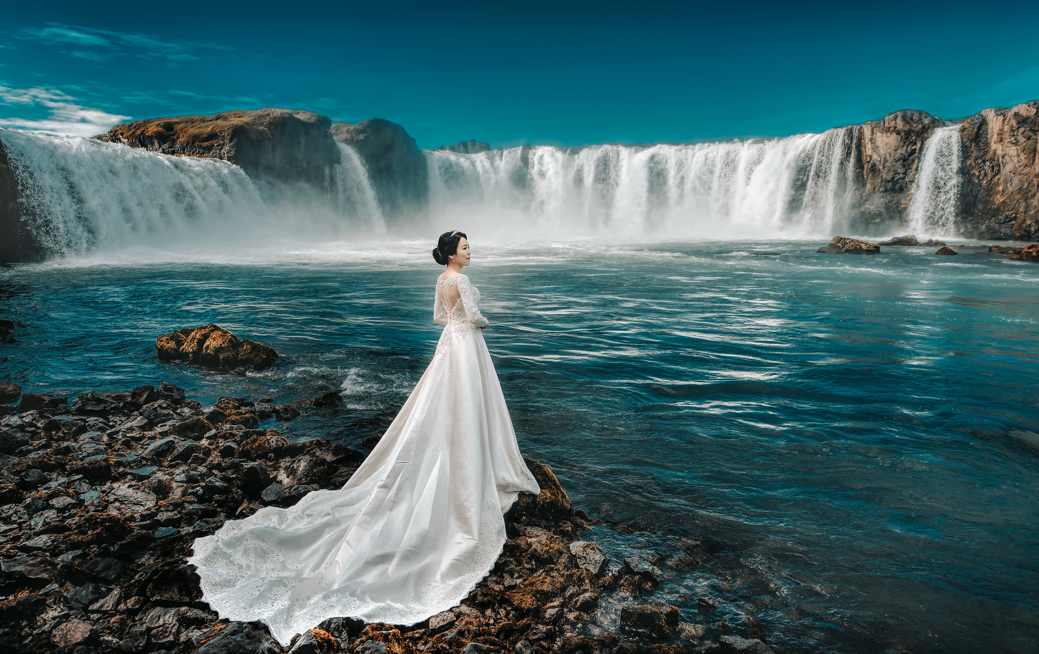 Godafoss-in Iceland-bride-in-cathedral-gown-against-waterfall-photo-by-edwin-tan-photography