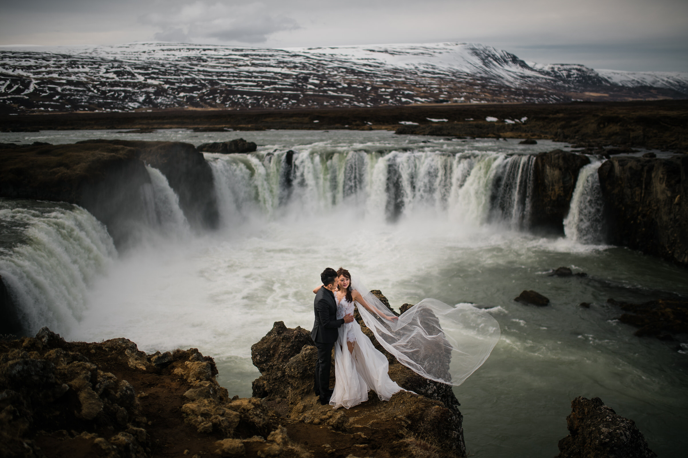 Godafoss-in Iceland-elopement-couple-at-epic-waterfall-in-iceland-m-and-j-studios