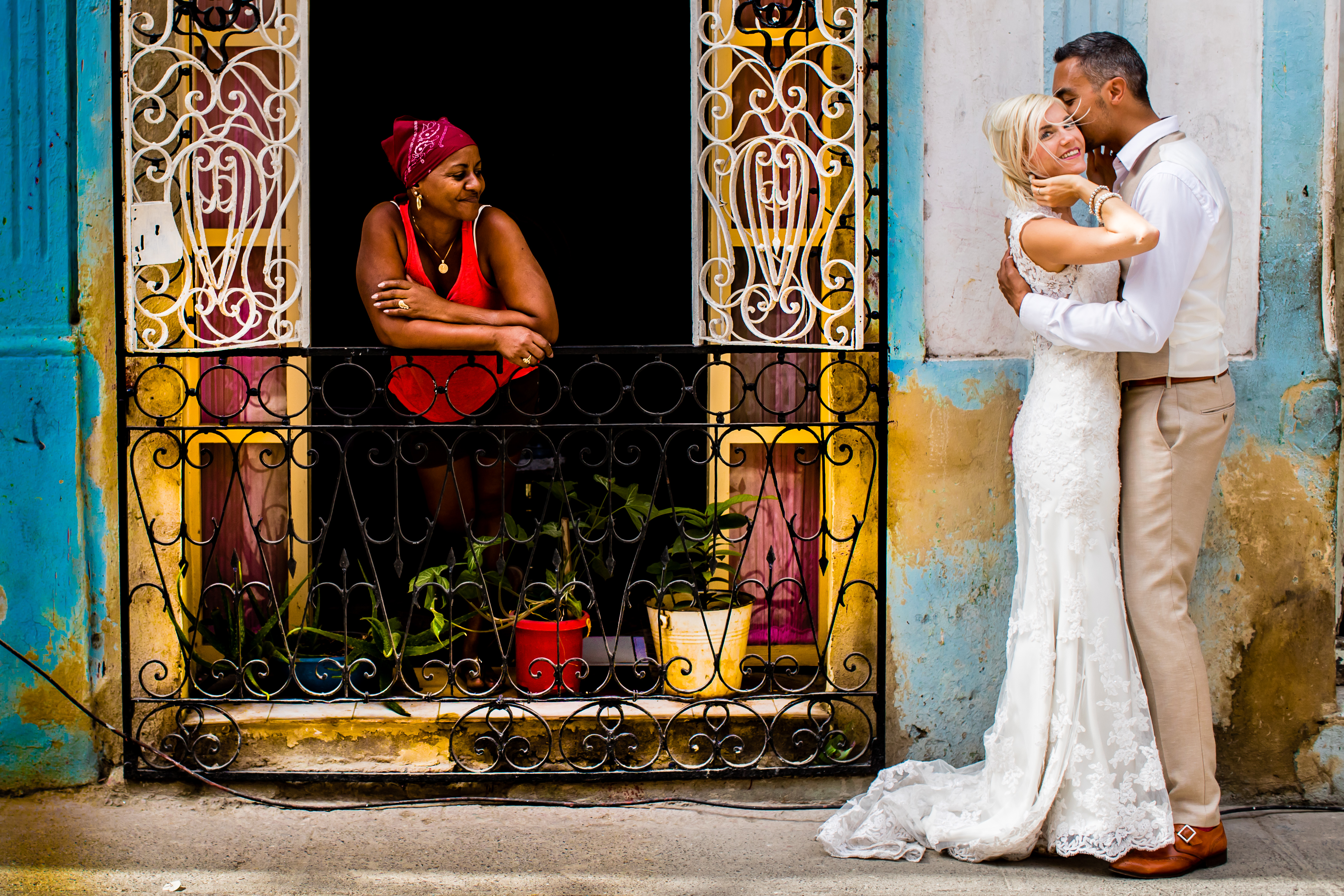Local women watches during elopement shot in Havana, Cuba - photo by Eppel Photography