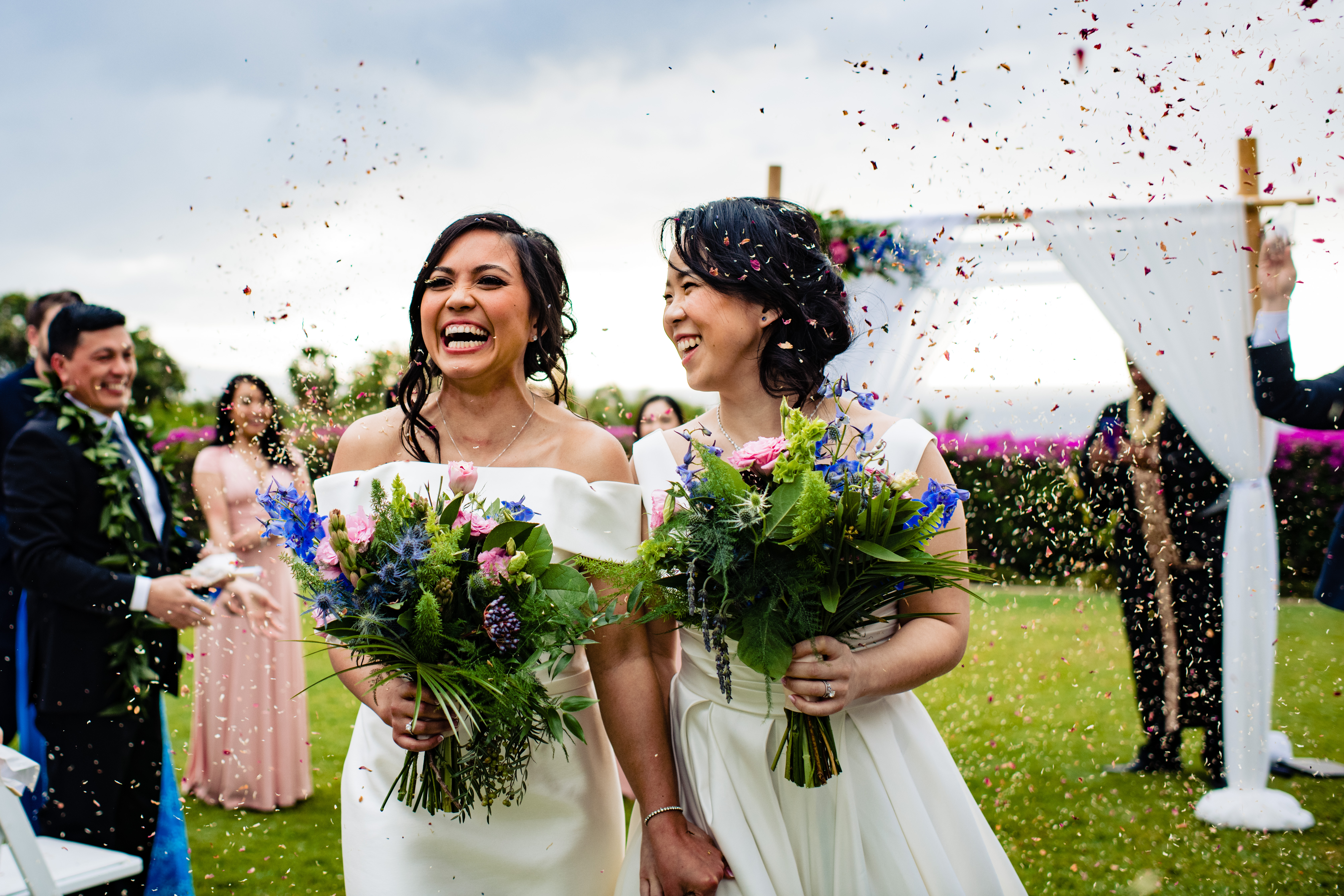 Just married brides laughing as they leave their ceremony - Angela Nelson, Maui