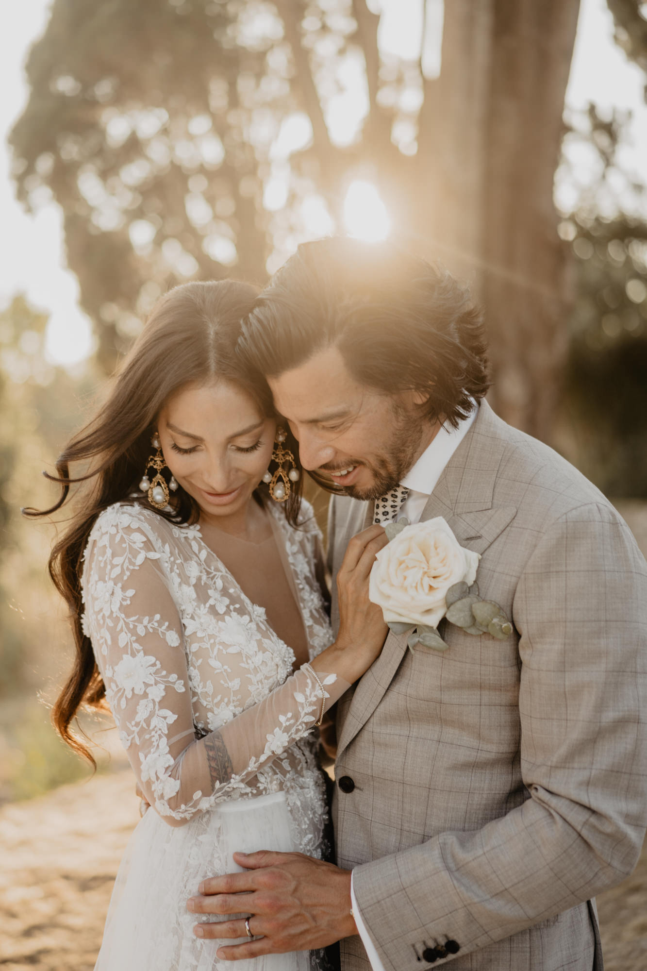 Italian-bride-in-long-sleeve-lace-wedding-gown-with-groom-david-bastianoni-italy