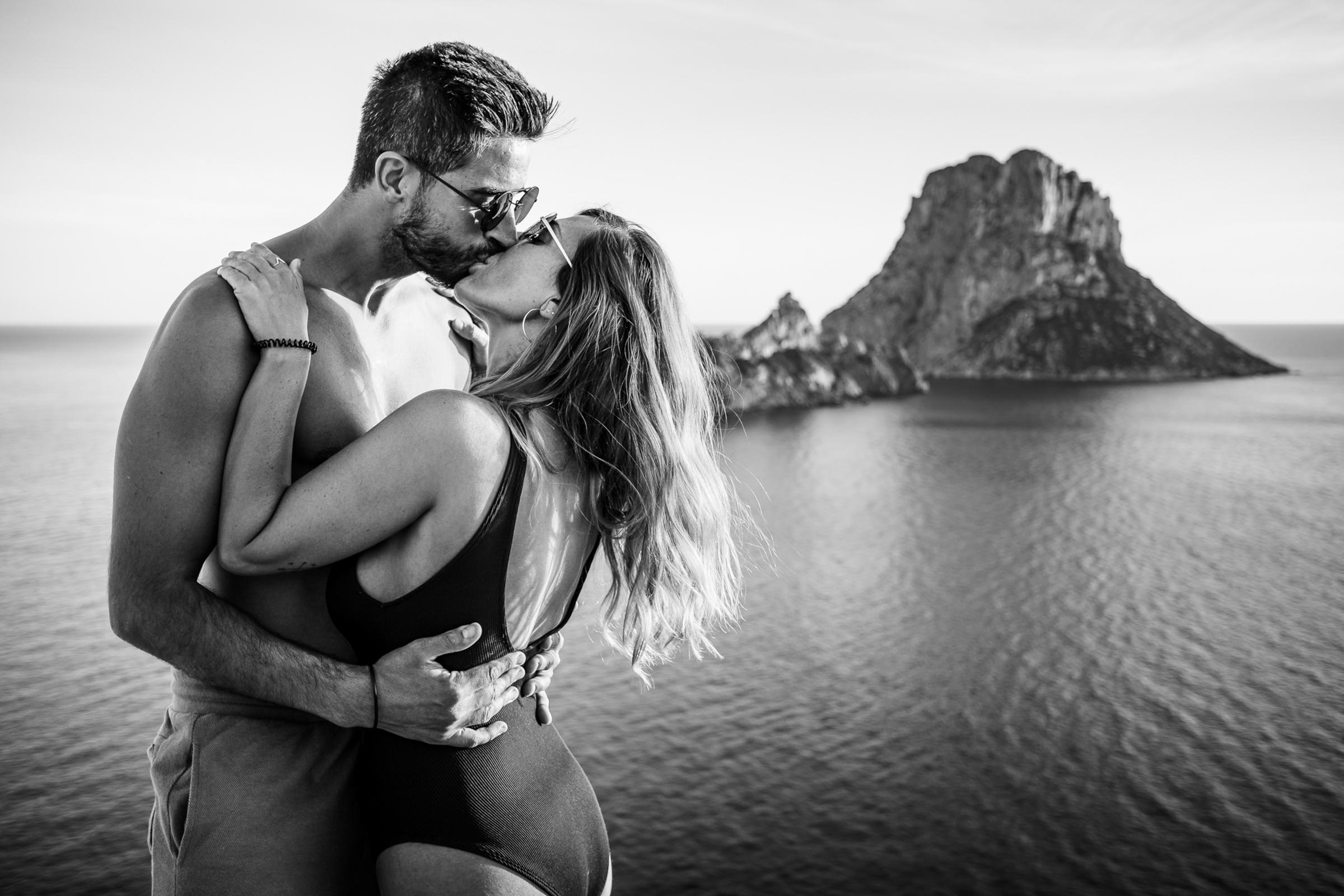 Portrait of couple against the Spanish landmark, Es Vedrà, by Julien Laurent Georges