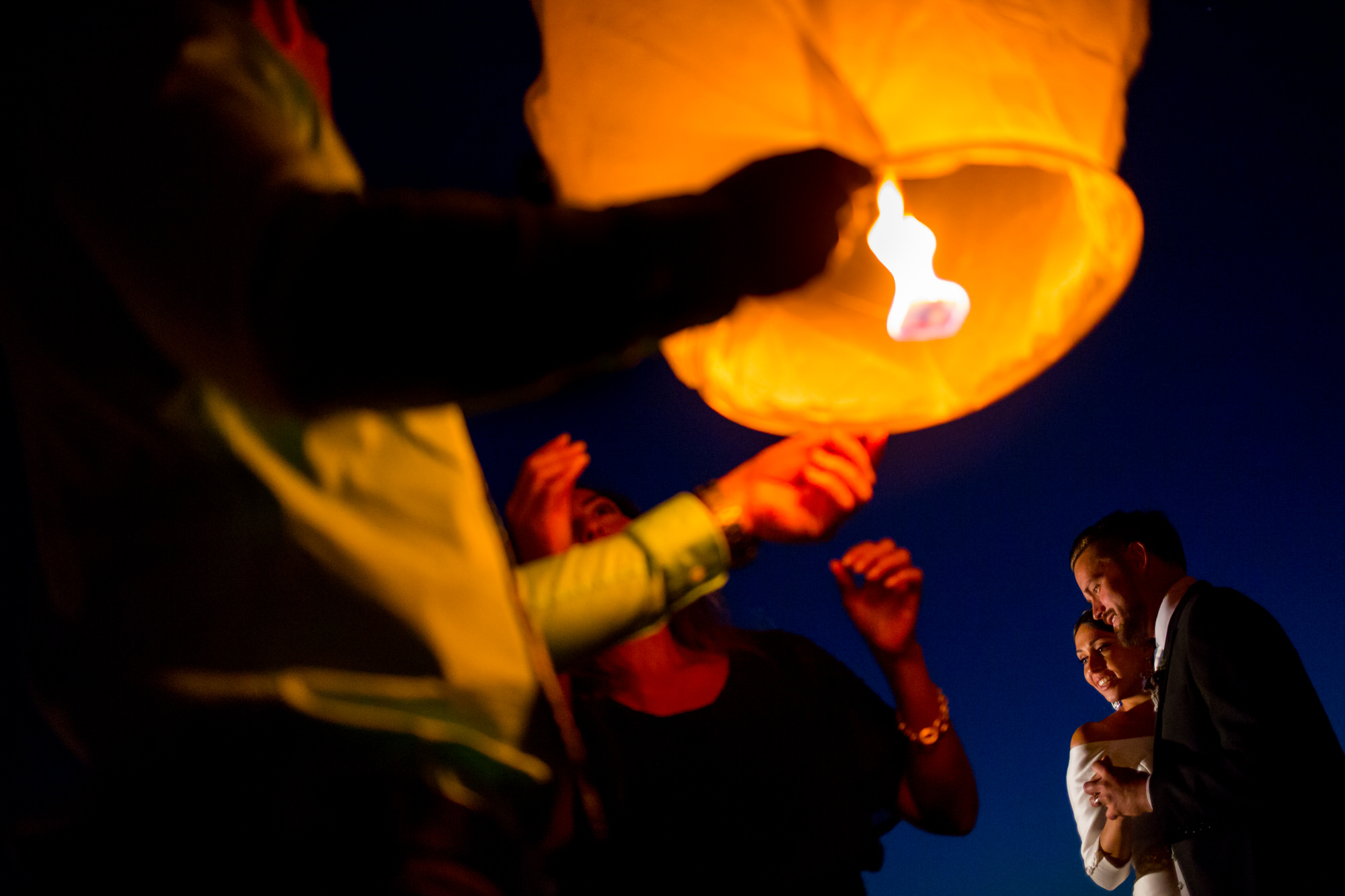 Bride and groom during lantern ceremony - photo by Tyler Wirken - Kansas City, Missouri