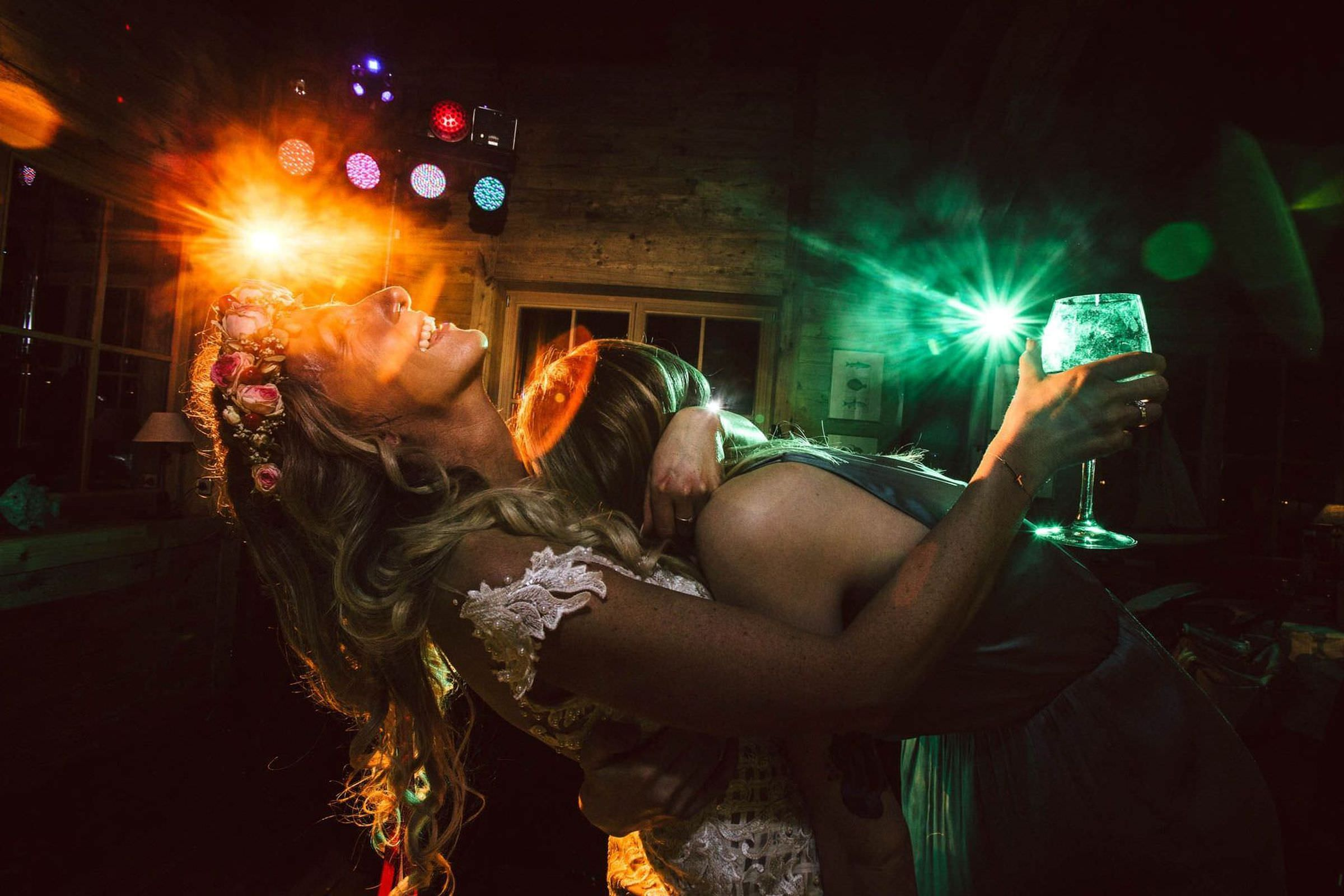 Fun shot of wedding guest dancing with bride by FineArt Weddings Photography from Germany
