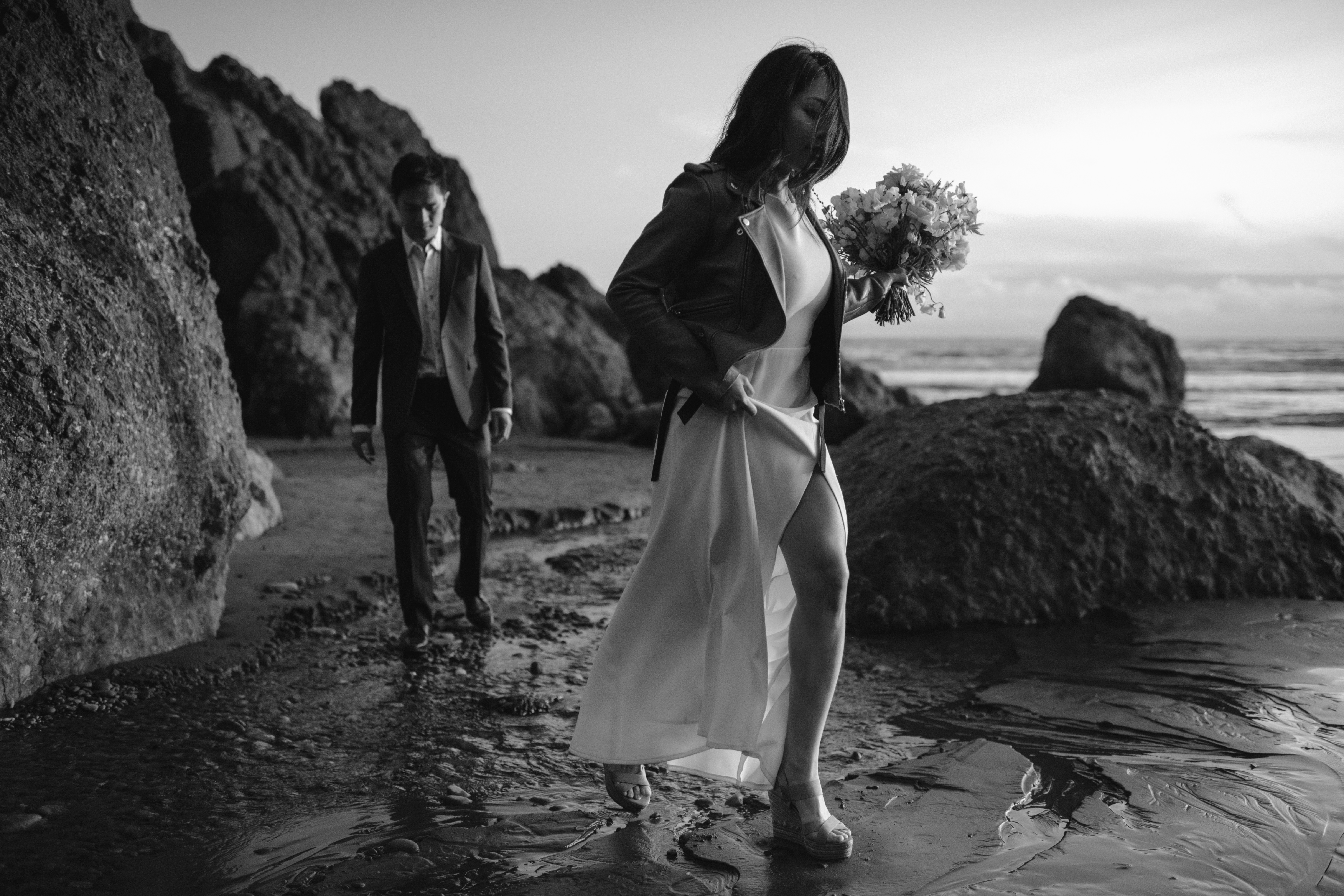 Moody black and white photo of couple at elopement on beach by Kristen Marie Parker