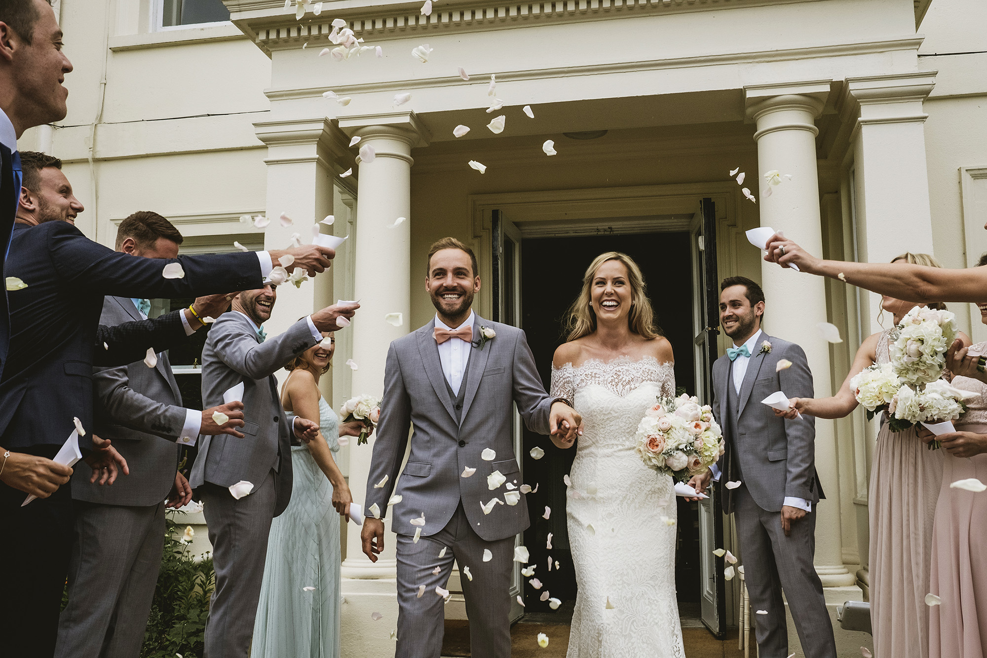Just married couple leaves their ceremony at Morden Hall in London - photo by York Place Studios