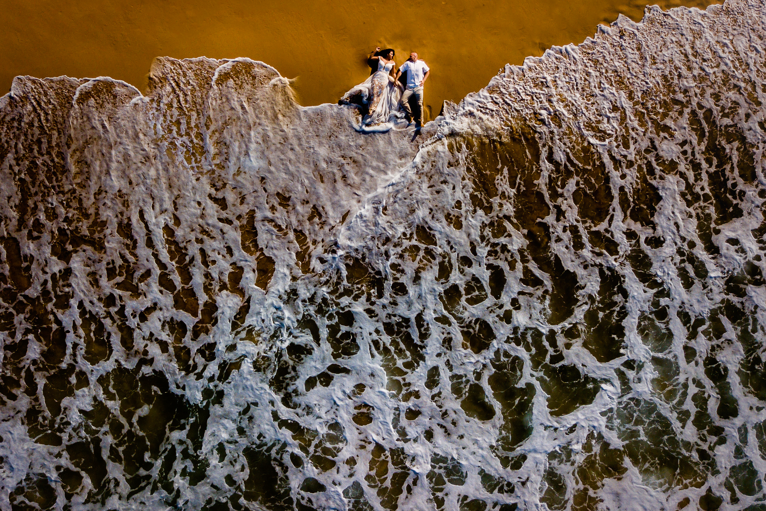 Drone photo of couple laying on beach in Puerto Rico - Eppel Photography
