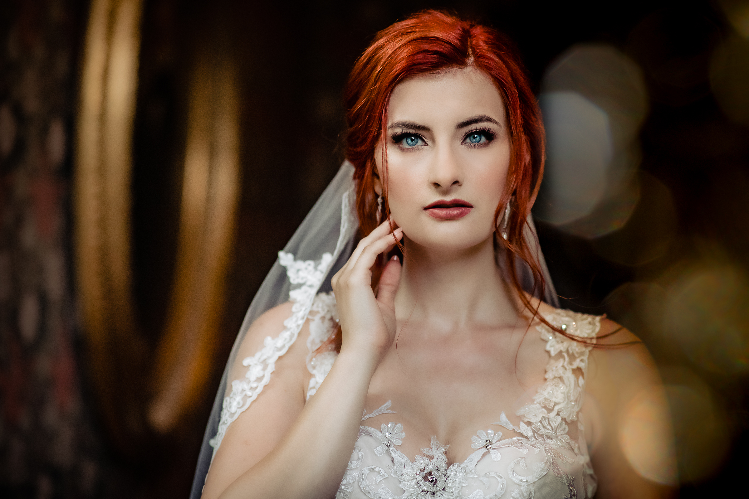 Bride with red hair and blue eyes wearing berry lipstick and dramatic eyelashes - photo by Eppel Photography - Netherlands