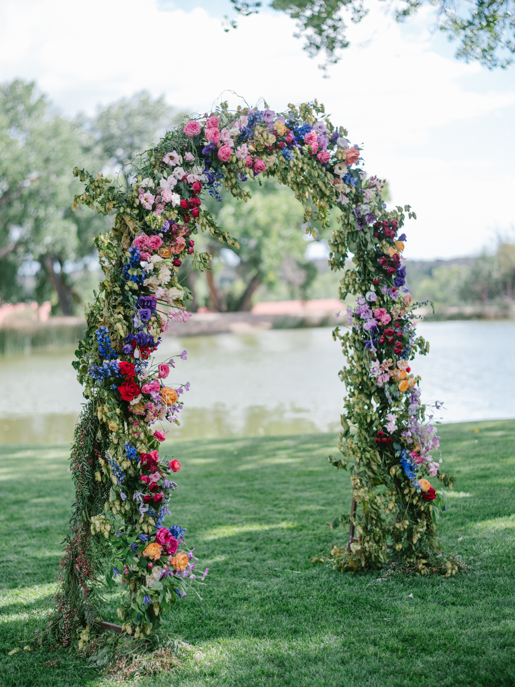Lovely summer floral arbor or roses, delphinium, and bellflower - photo by Amy and Stuart - LA
