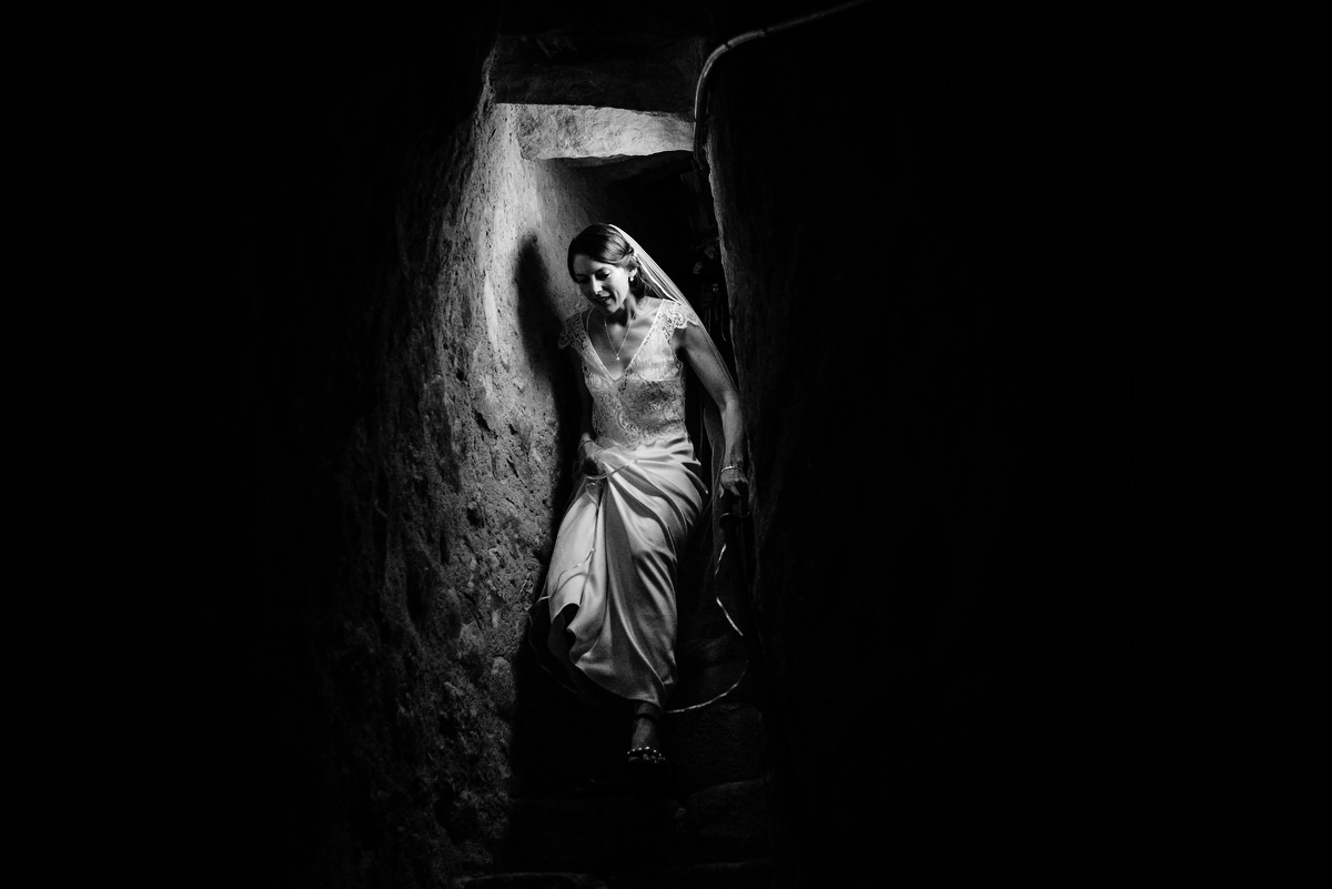 Bride descending stone stairs in Umbria, Italy - photographed by Samo Rovan